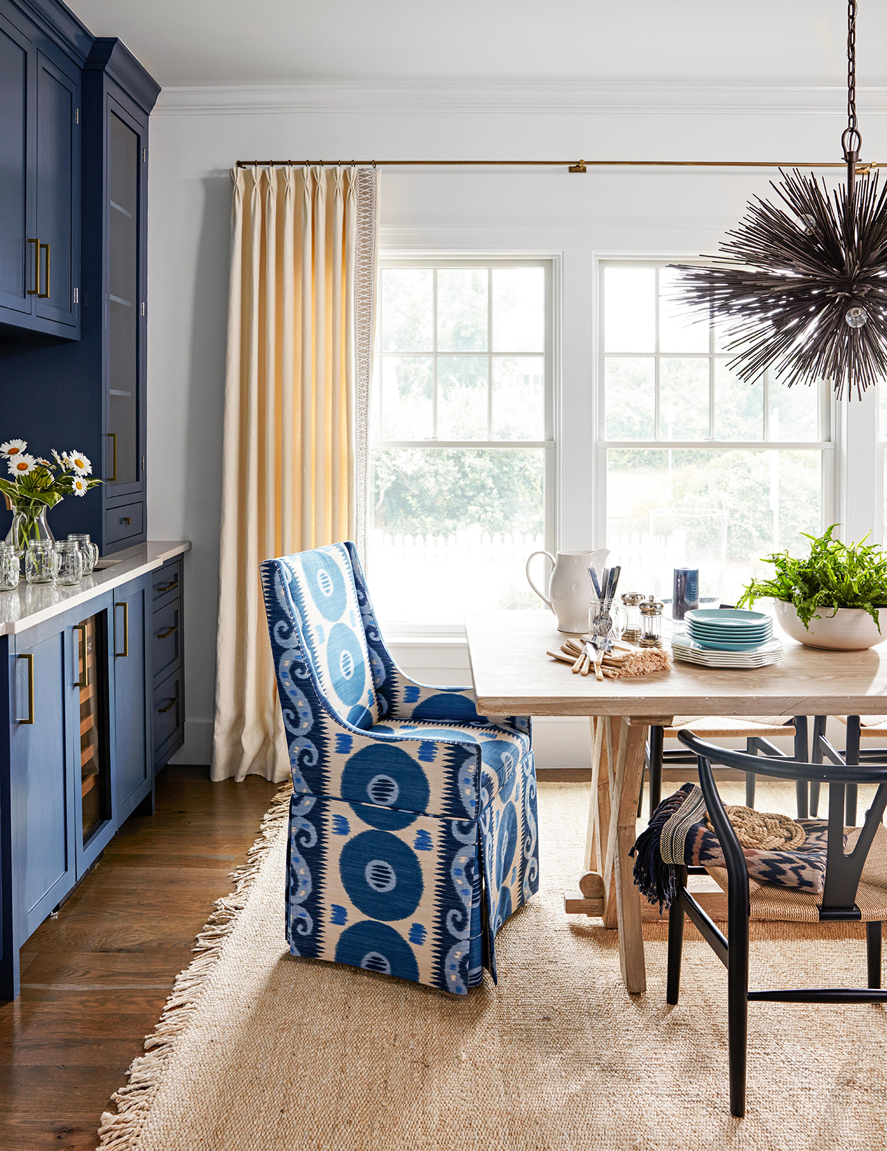 dining room with blue painted cabinets and blue chair