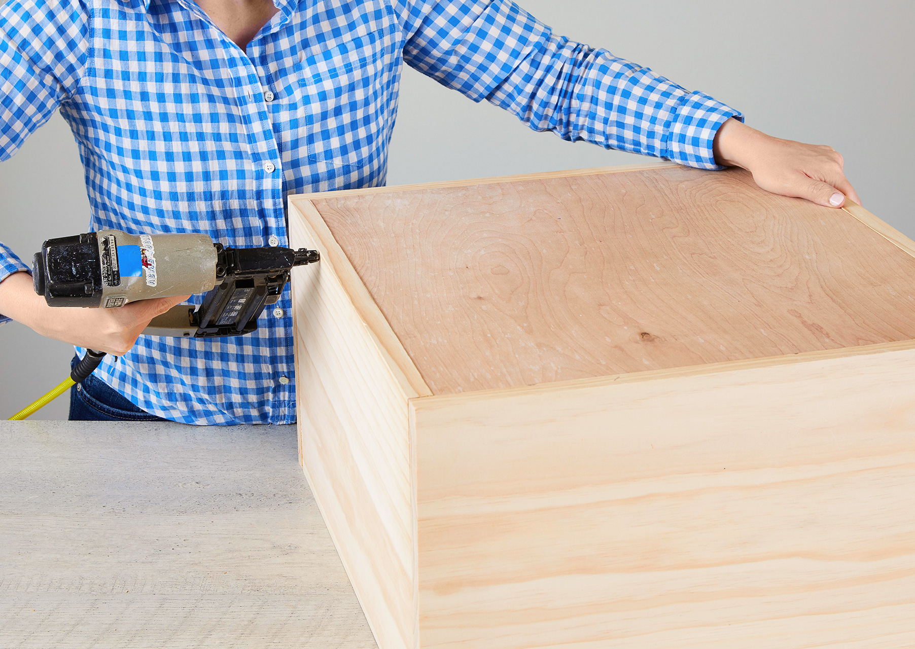 secure back piece to nightstand with nails