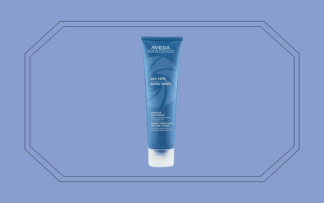 aveda sun care masque on blue backdrop