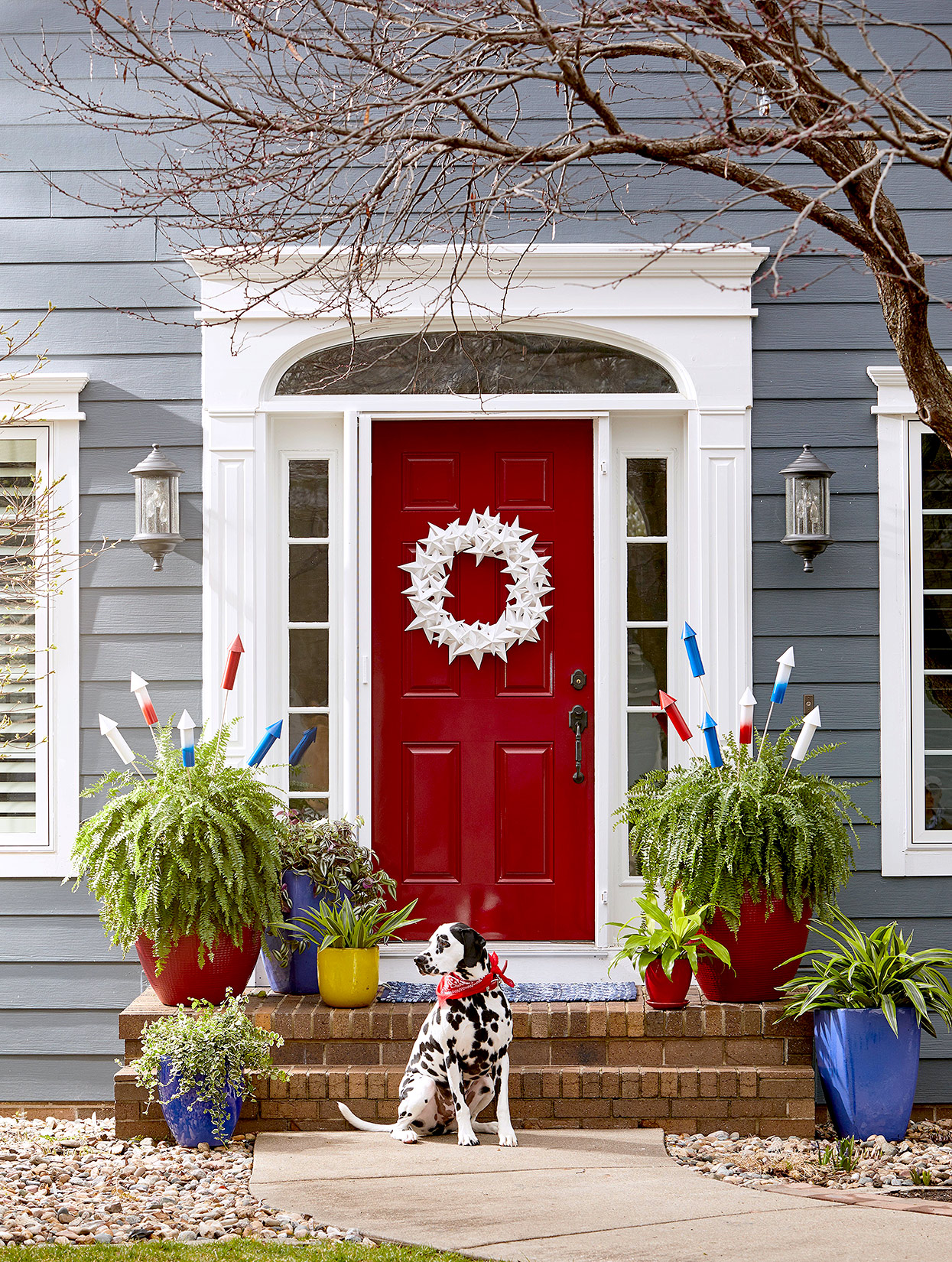 house facade with patriotic decor and dalmation
