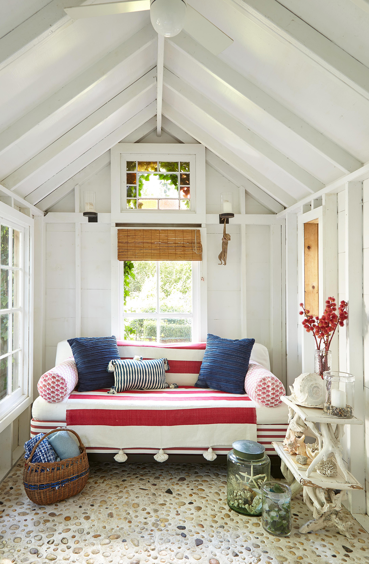 vaulted cottage room with red and blue textiles