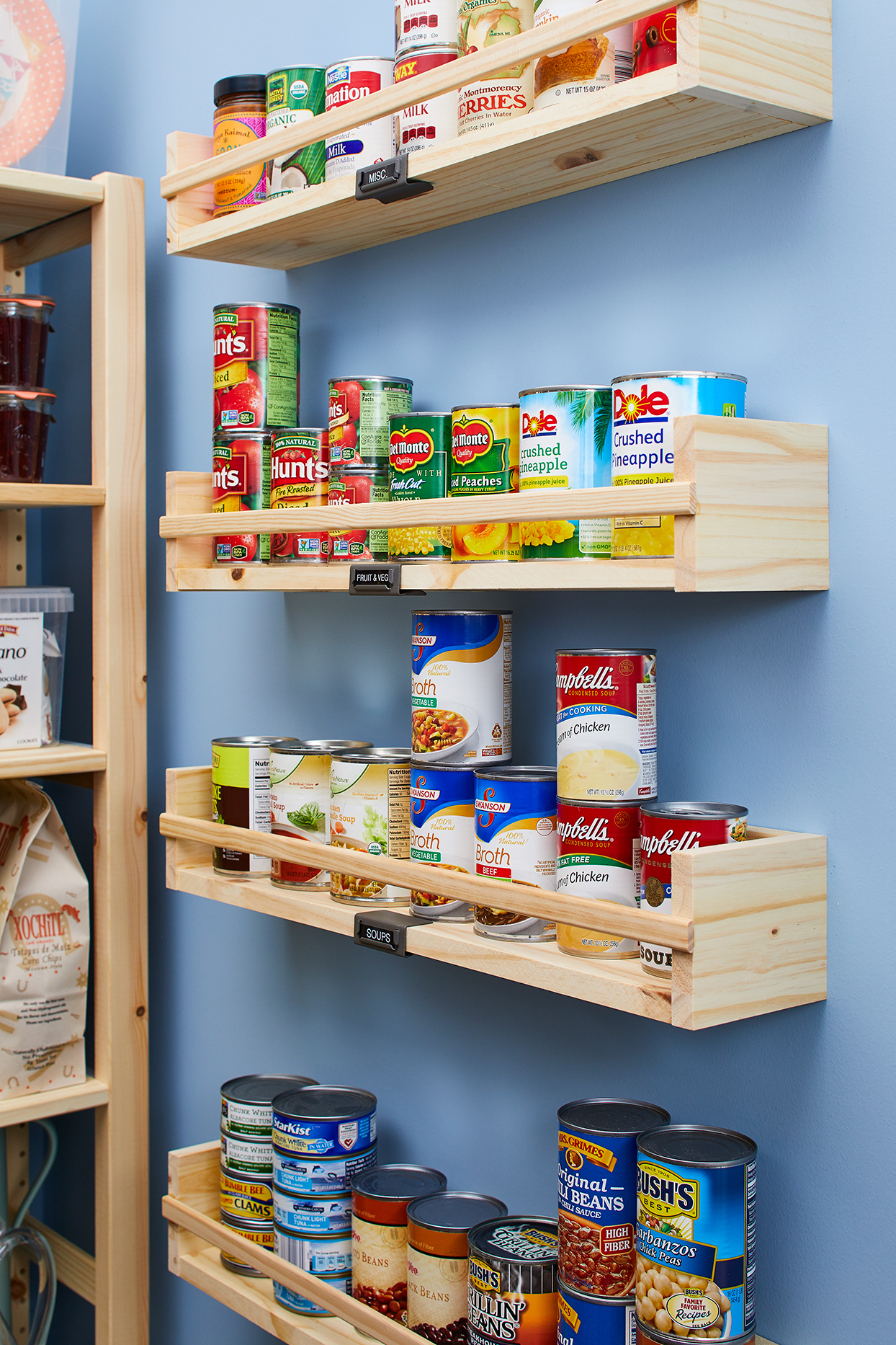 Shelves of canned food in pantry