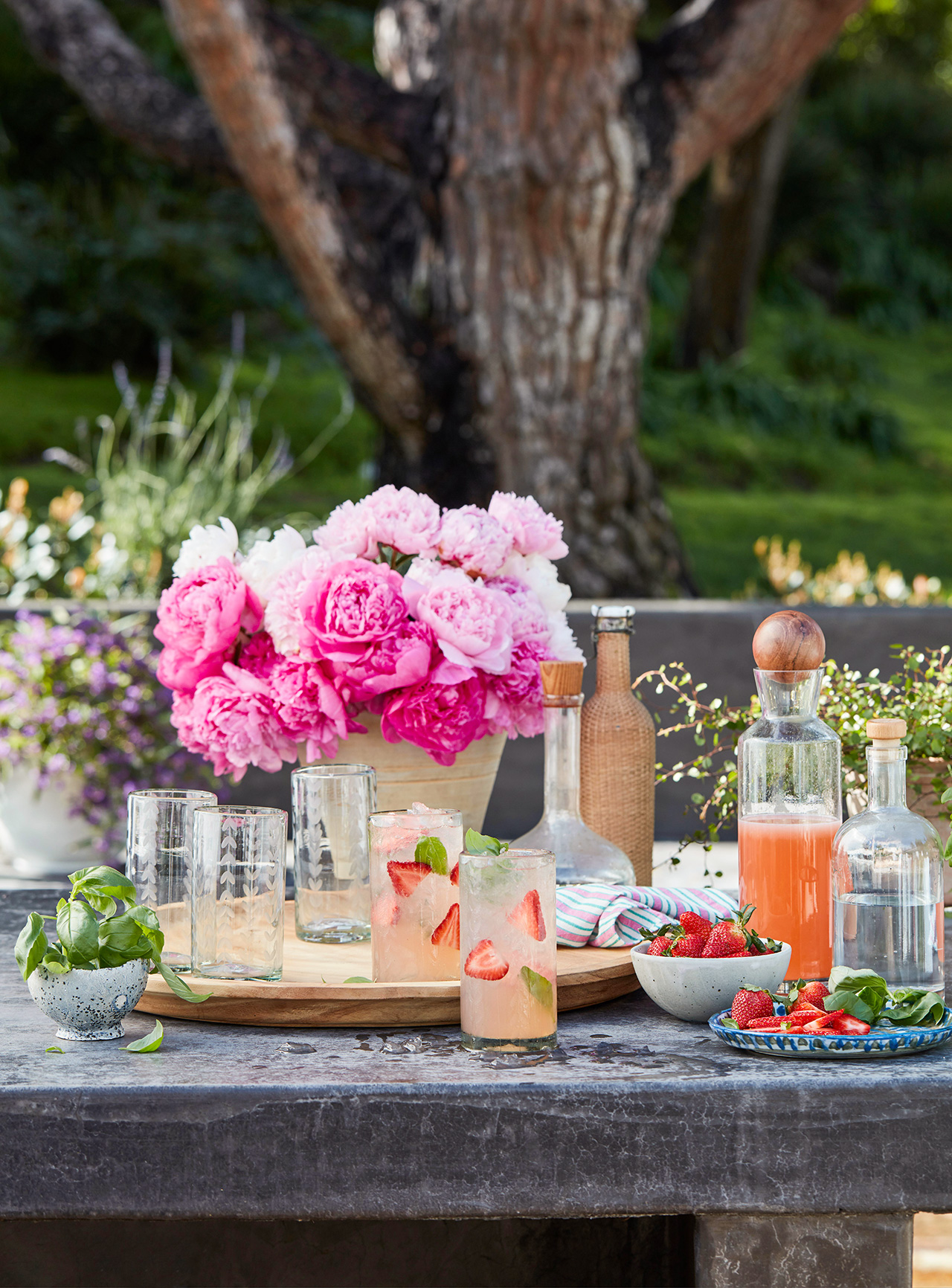table setting with peonies and strawberry beverages