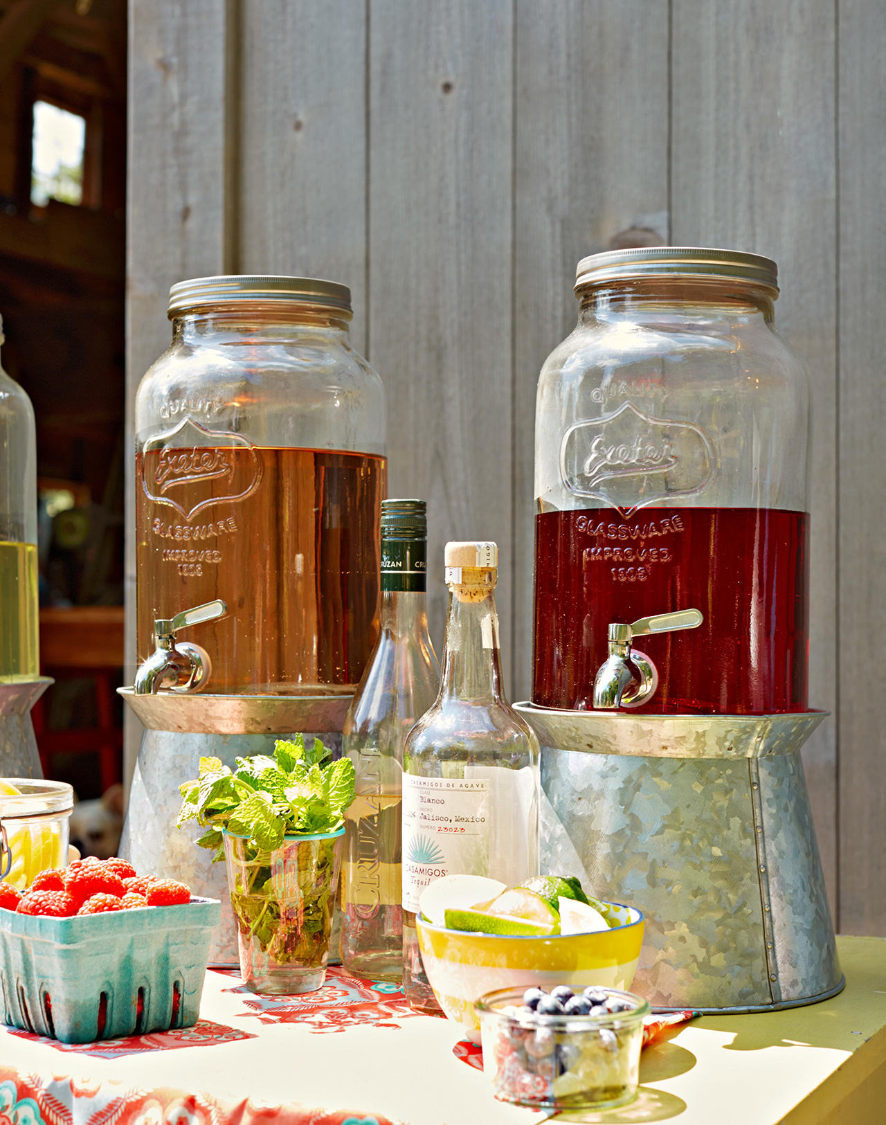 outdoor wine station in large jars with fruit