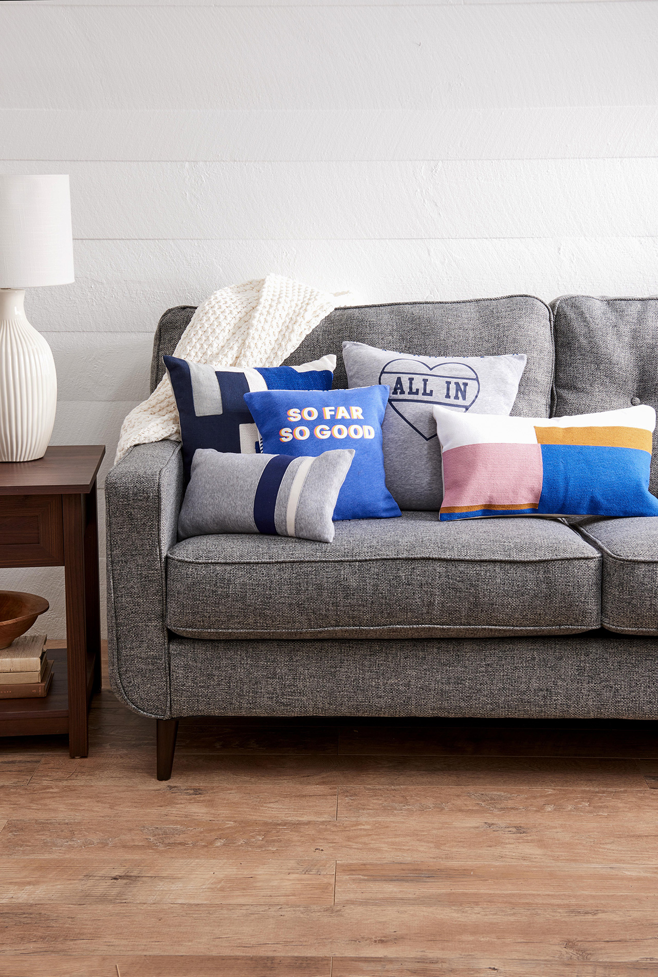 gray sofa with graphic throw pillows
