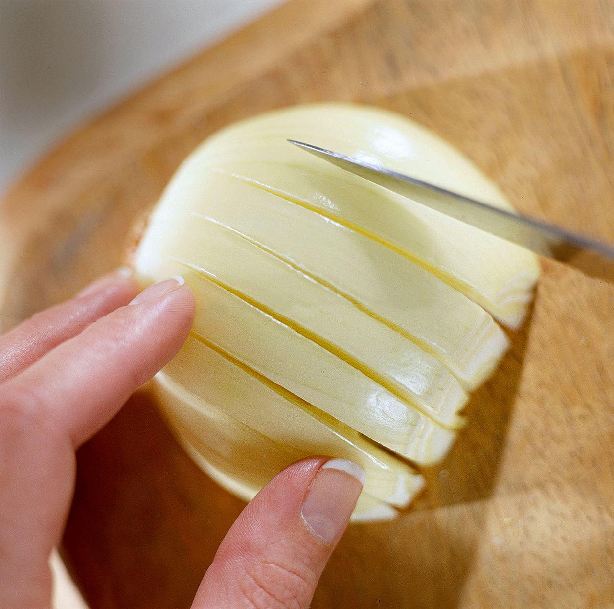make vertical slices partway through onion