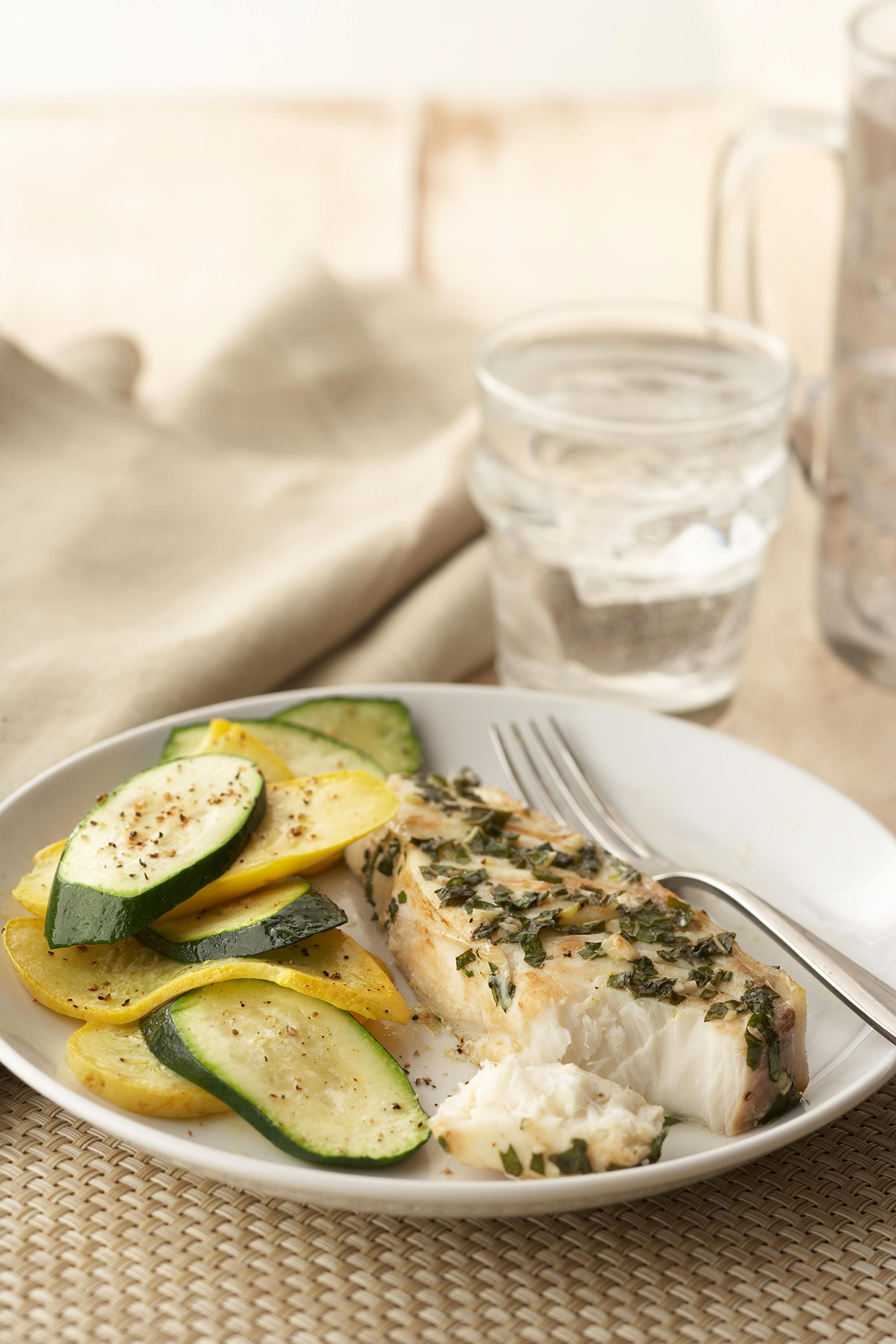 Zucchini Chips on white plate with fish
