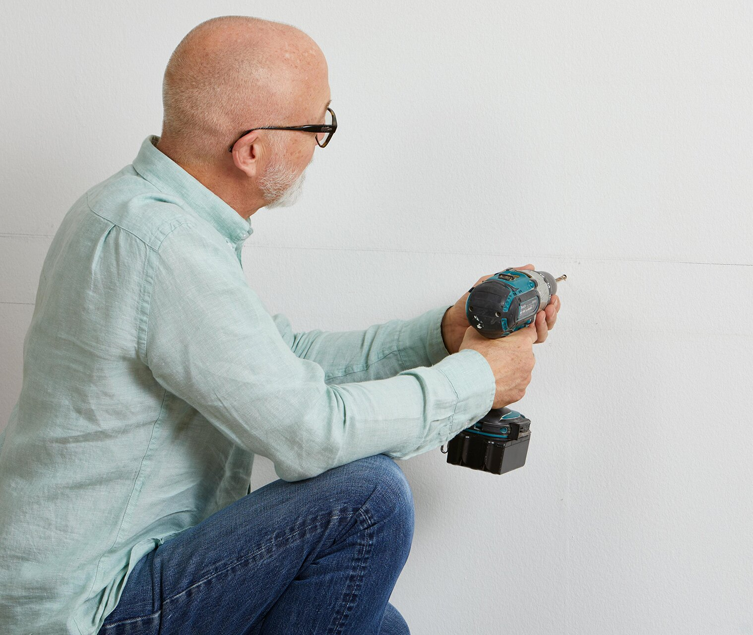making wall hole with electric drill