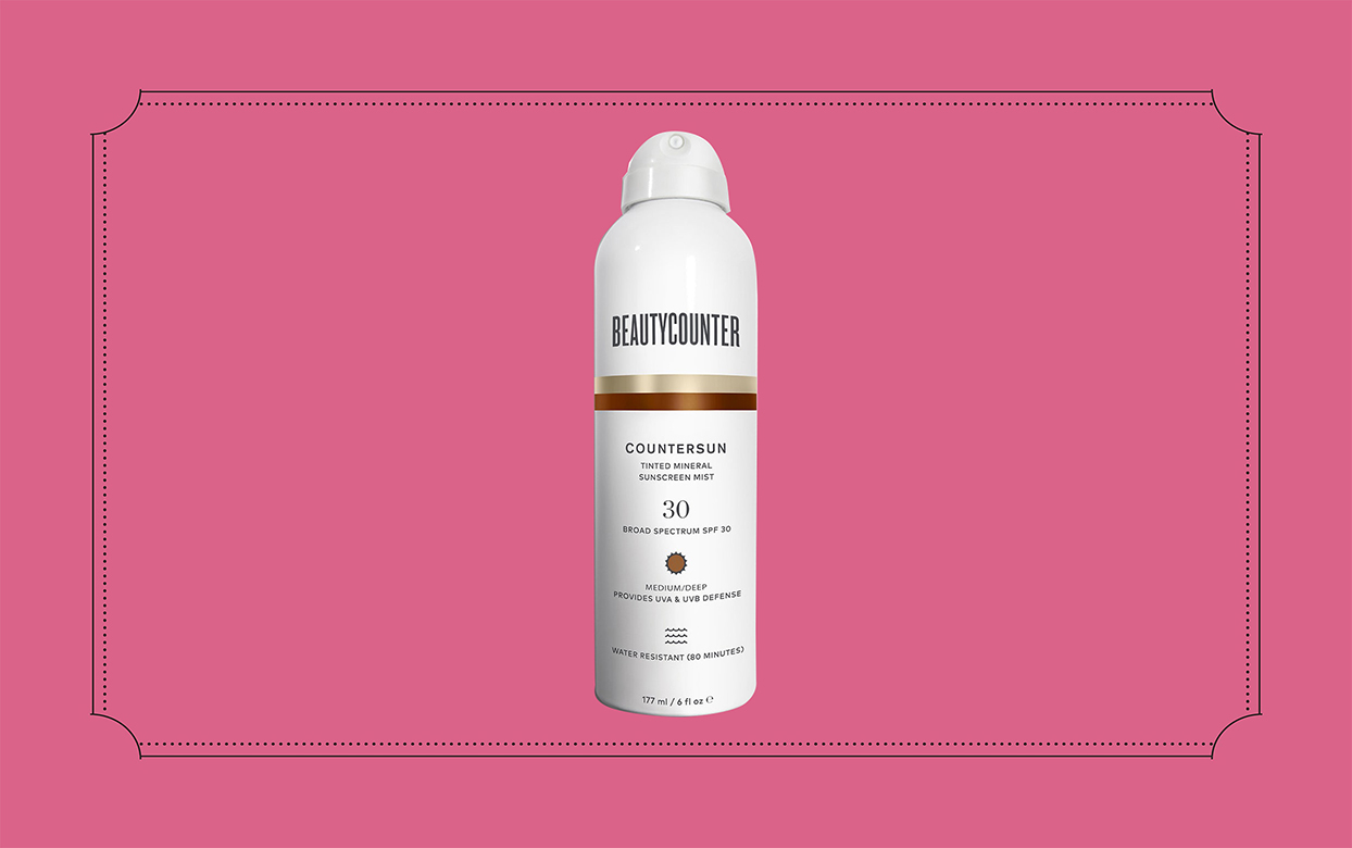 beauty counter tinted sunscreen spray on pink background
