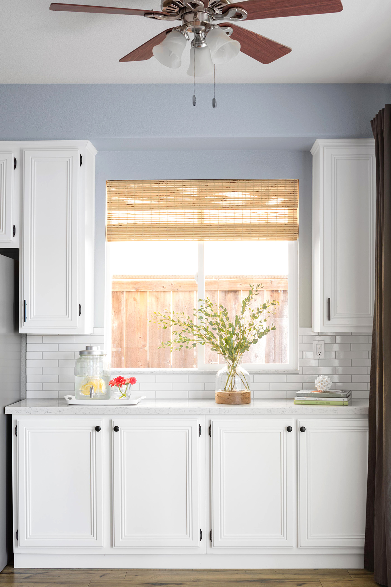 bamboo shades above kitchen counter