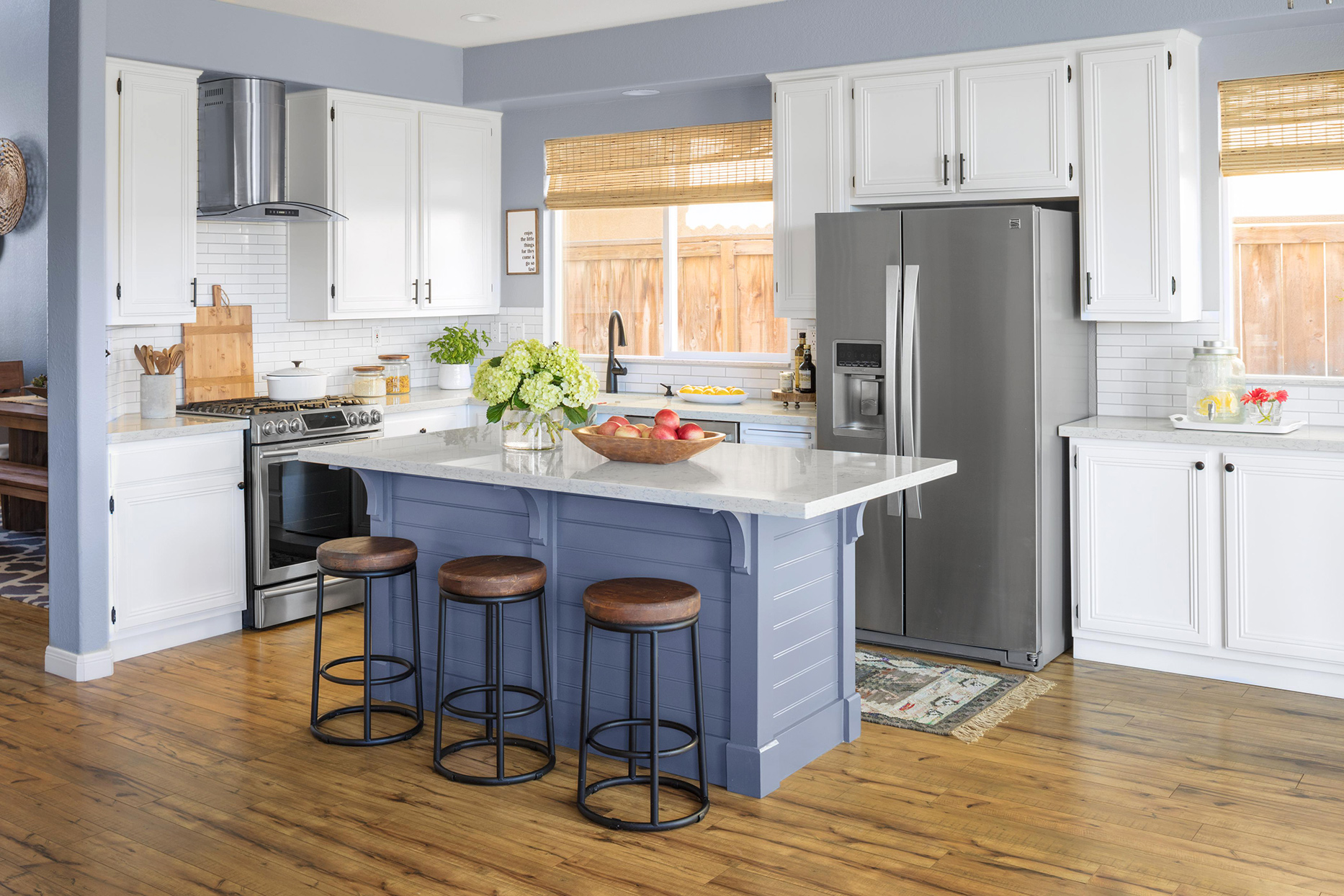 kitchen with muted cool hues and blue island