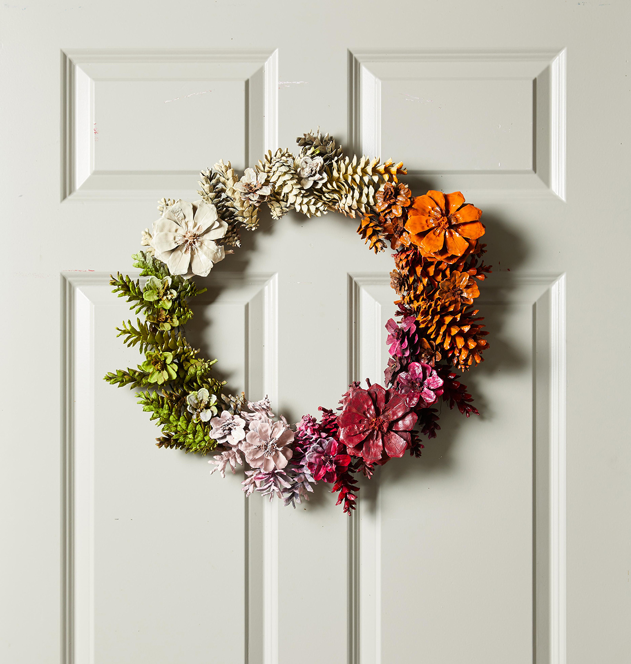 colorblock wreath with painted pine cones