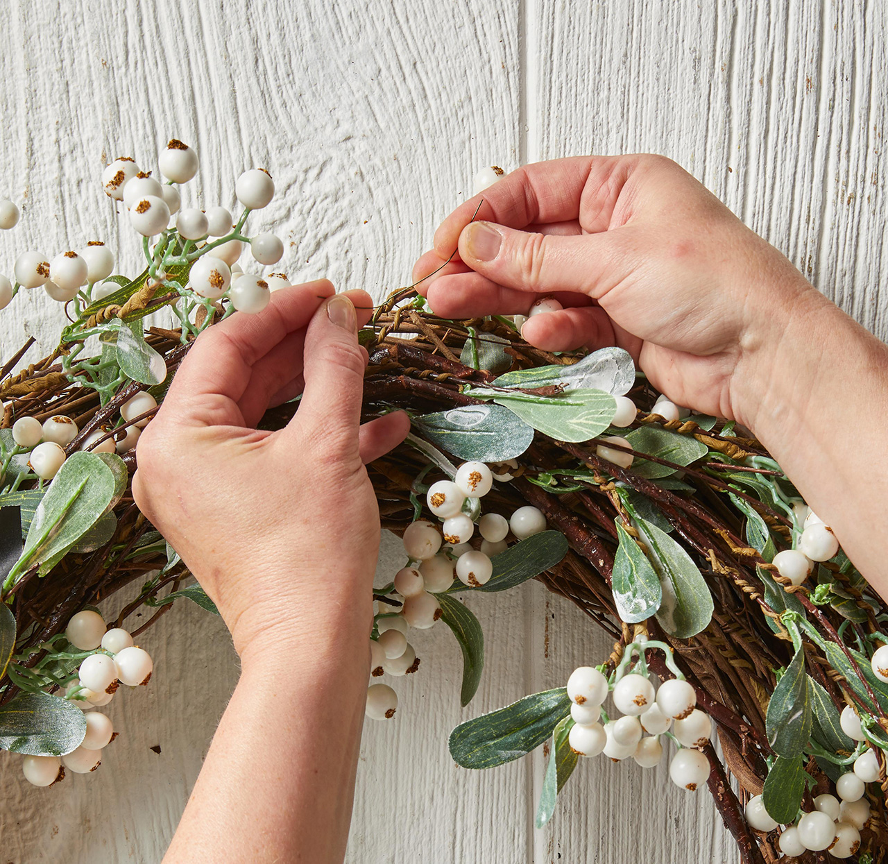 securing dogwood greenery branches with wire