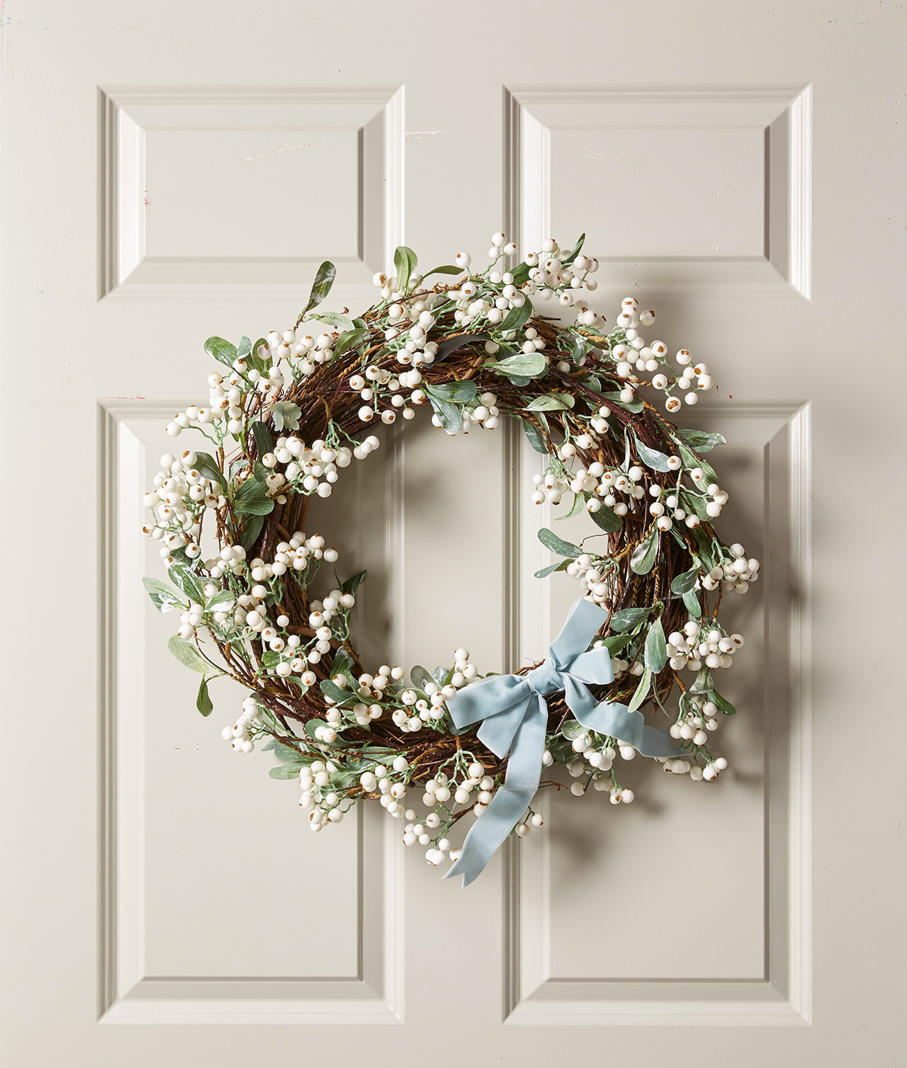 spring wreath with blue velvet ribbon