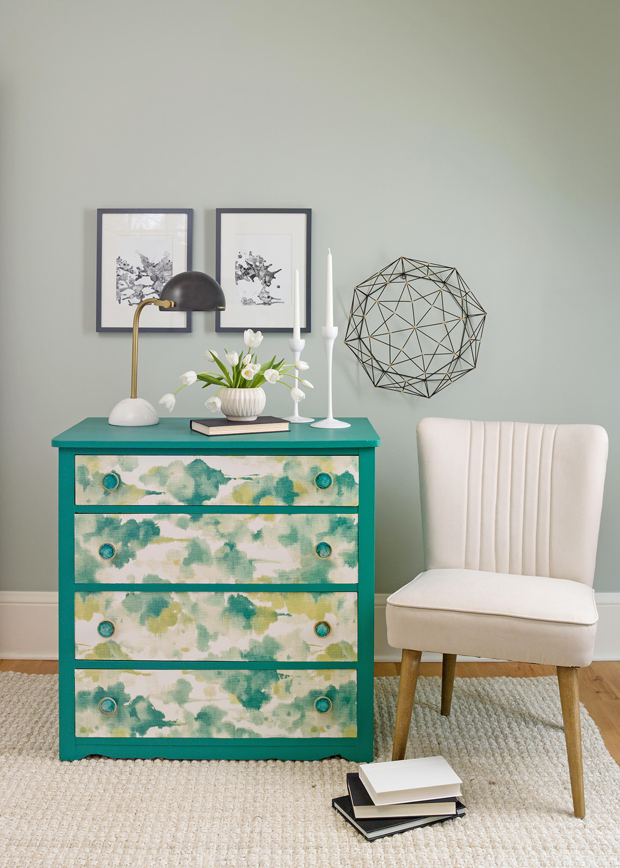 teal, yellow, and white papered dresser in gray room