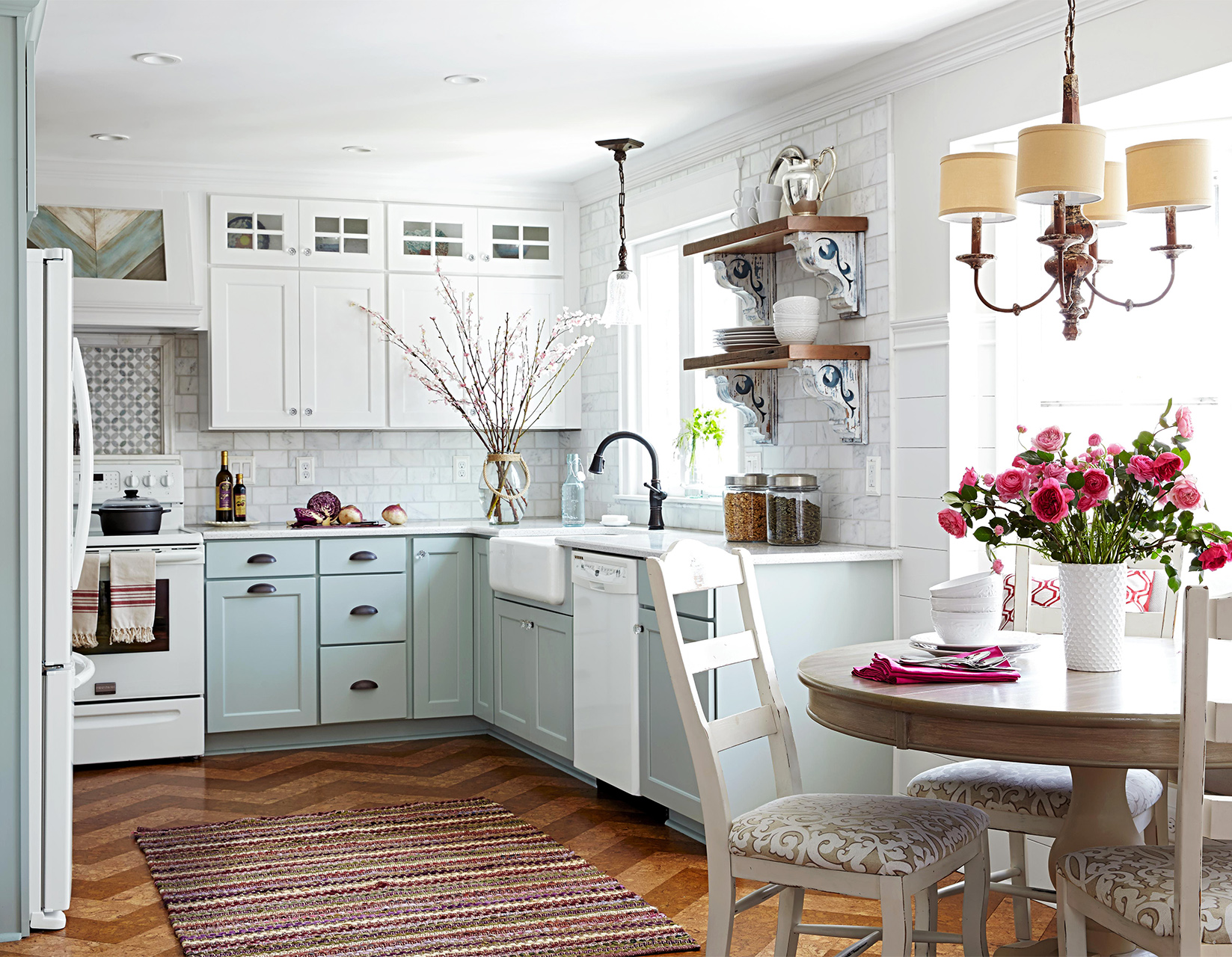 patterned wall and floor in pale blue kitchen