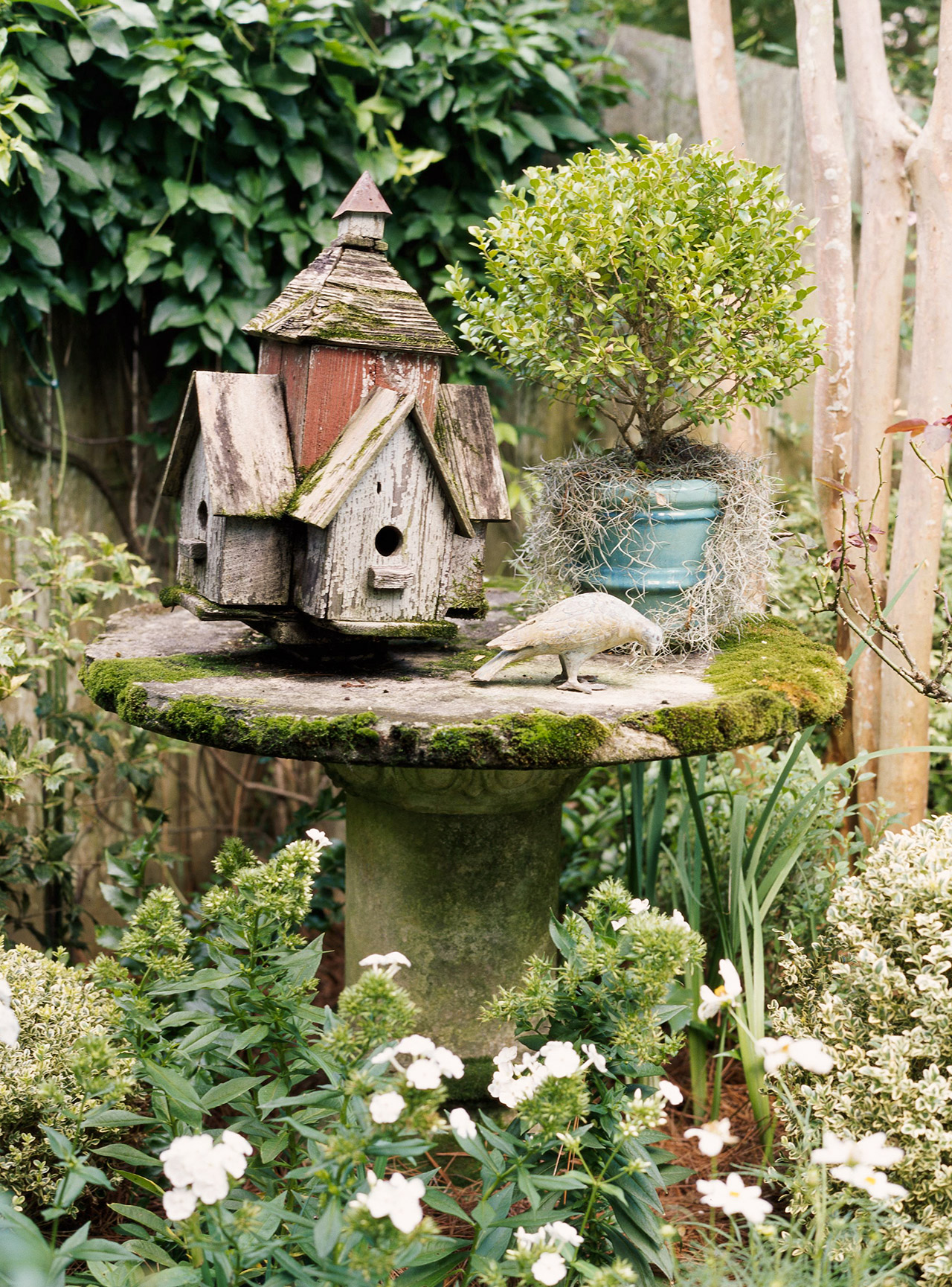 bird house and decor in flower garden