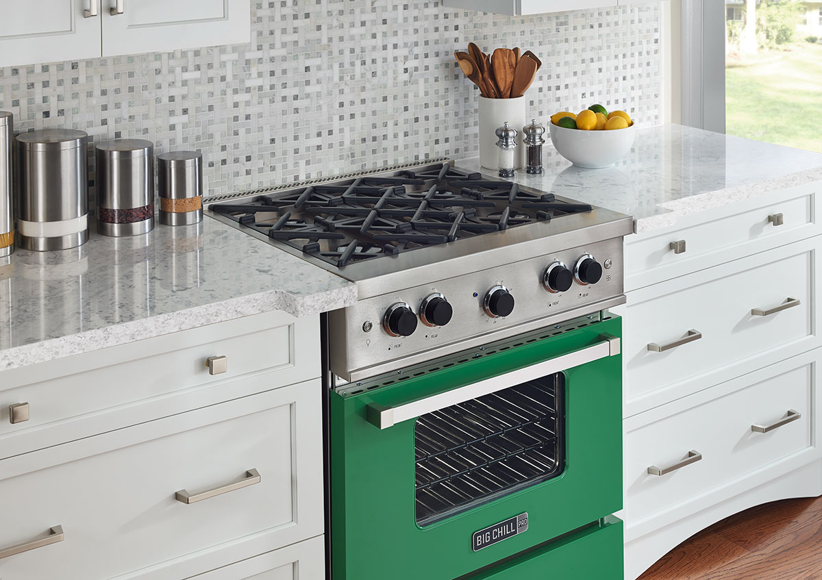 dark green big chill oven in white and gray kitchen