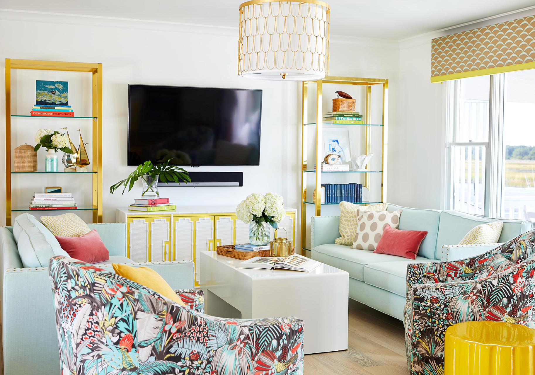 living room with teal couches yellow accents
