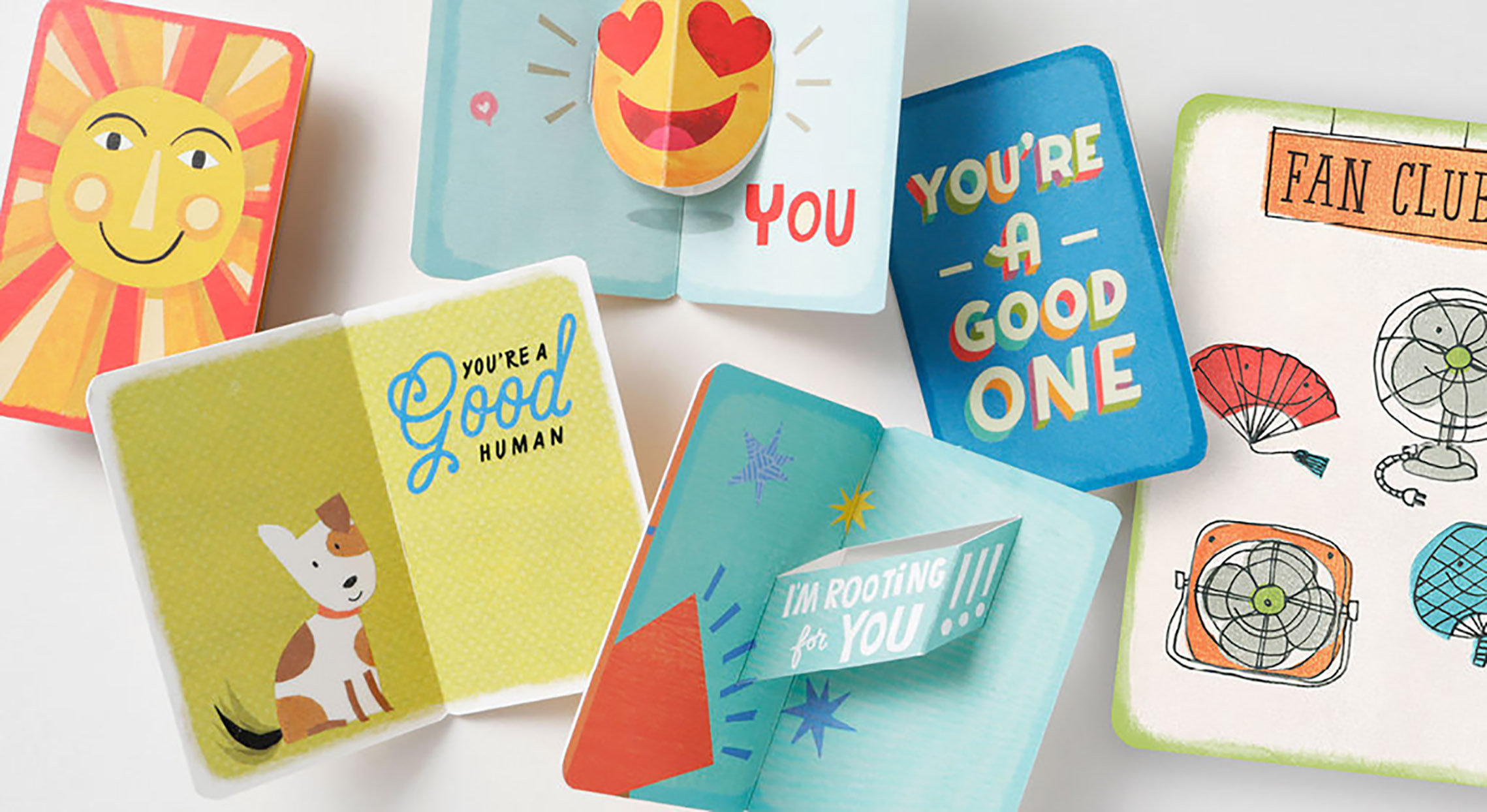 Greeting cards laying on a white tabletop