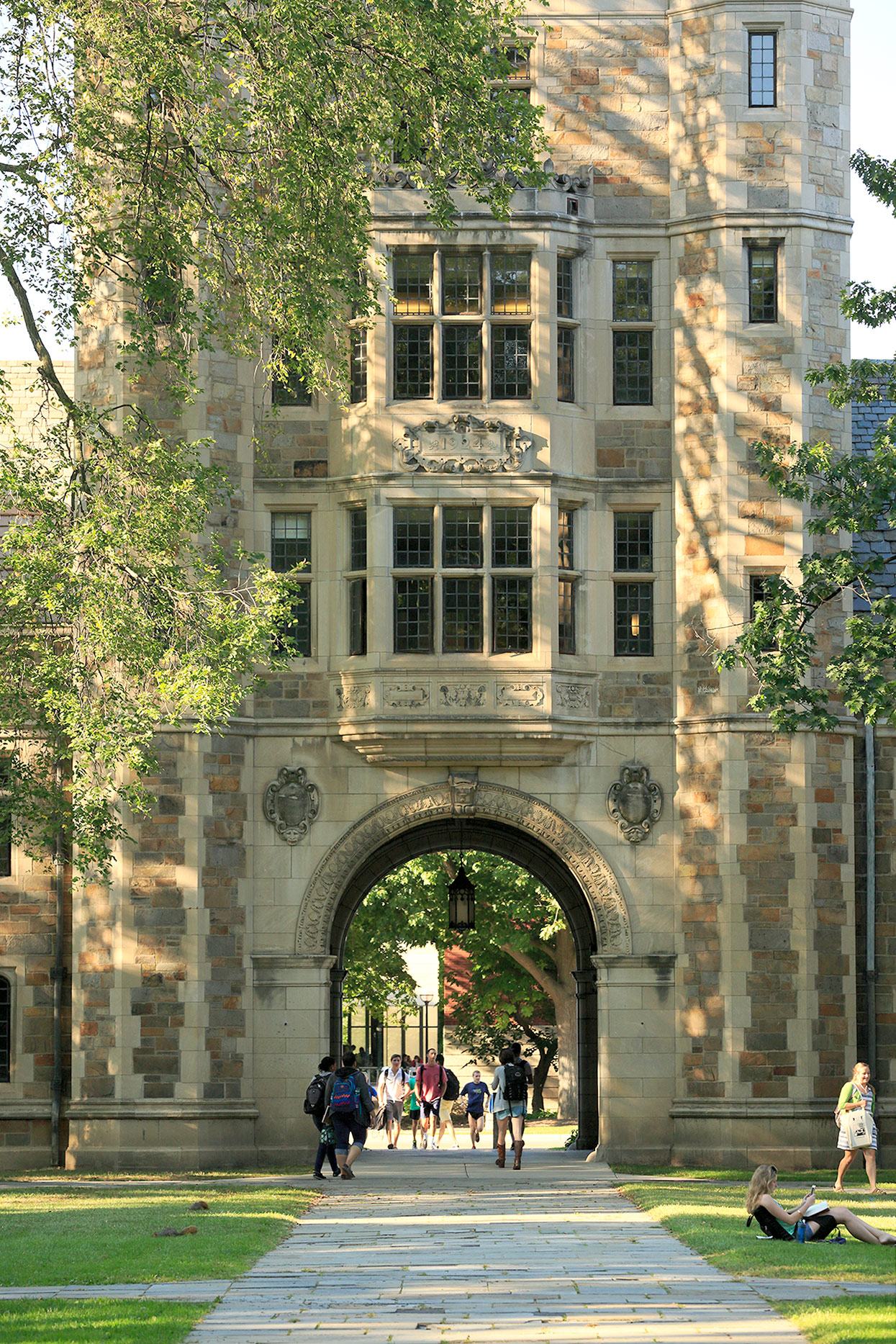 students walking on college campus near building
