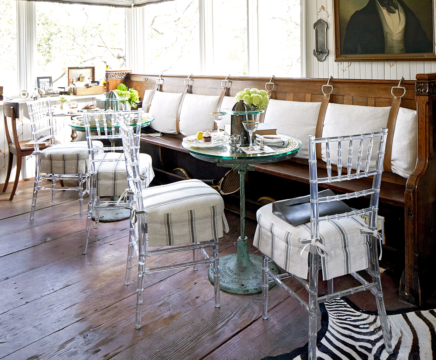 eclectic window banquette with acrylic chairs