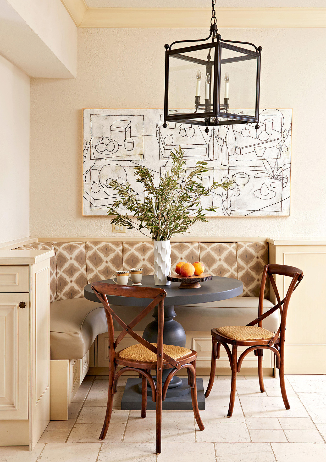 neutral banquette corner with large modern art