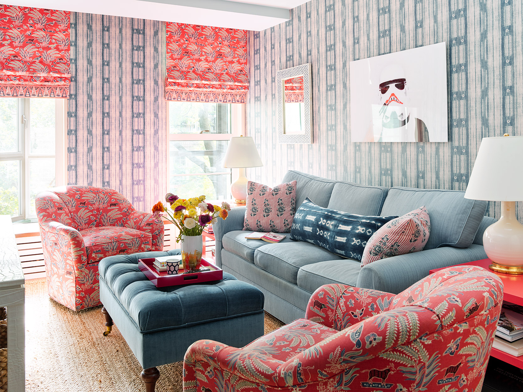 blue red decorated living room furniture and art