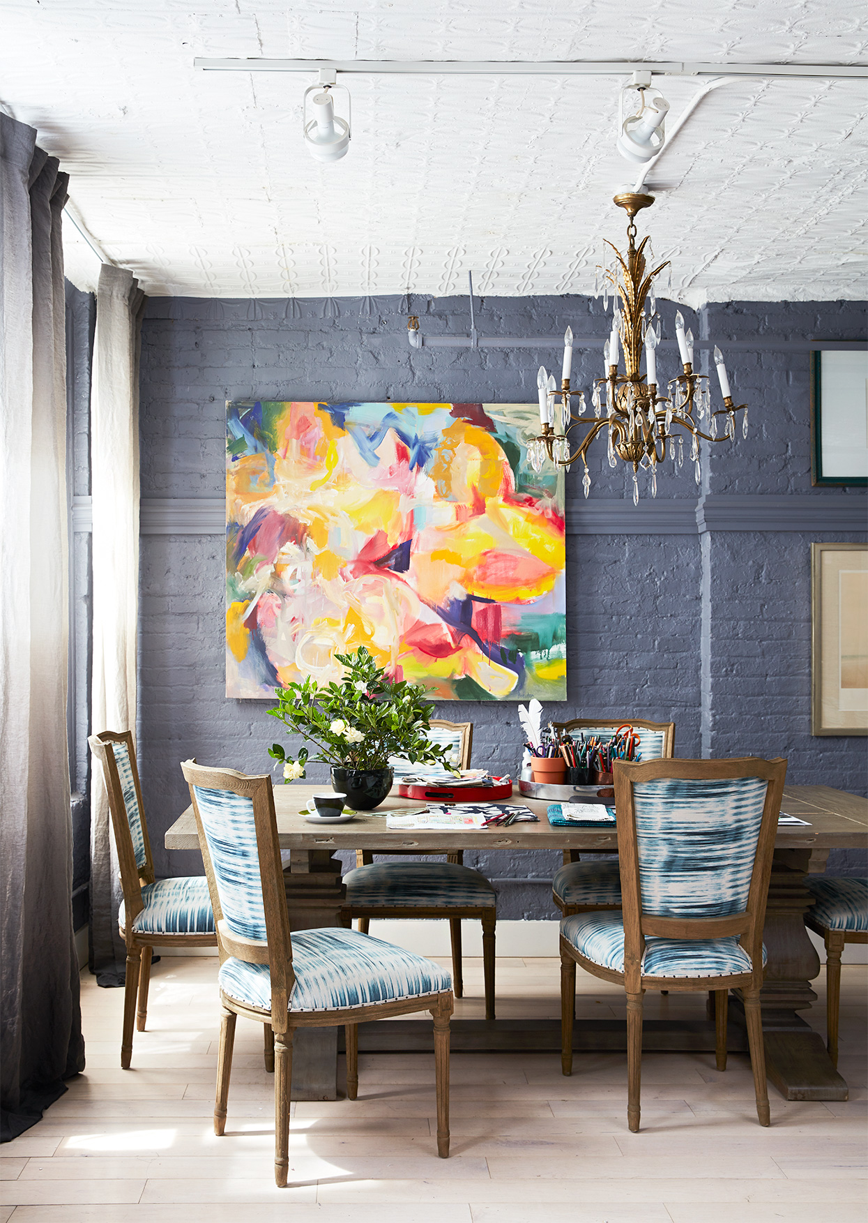 dining room with muted blue painted interior brick