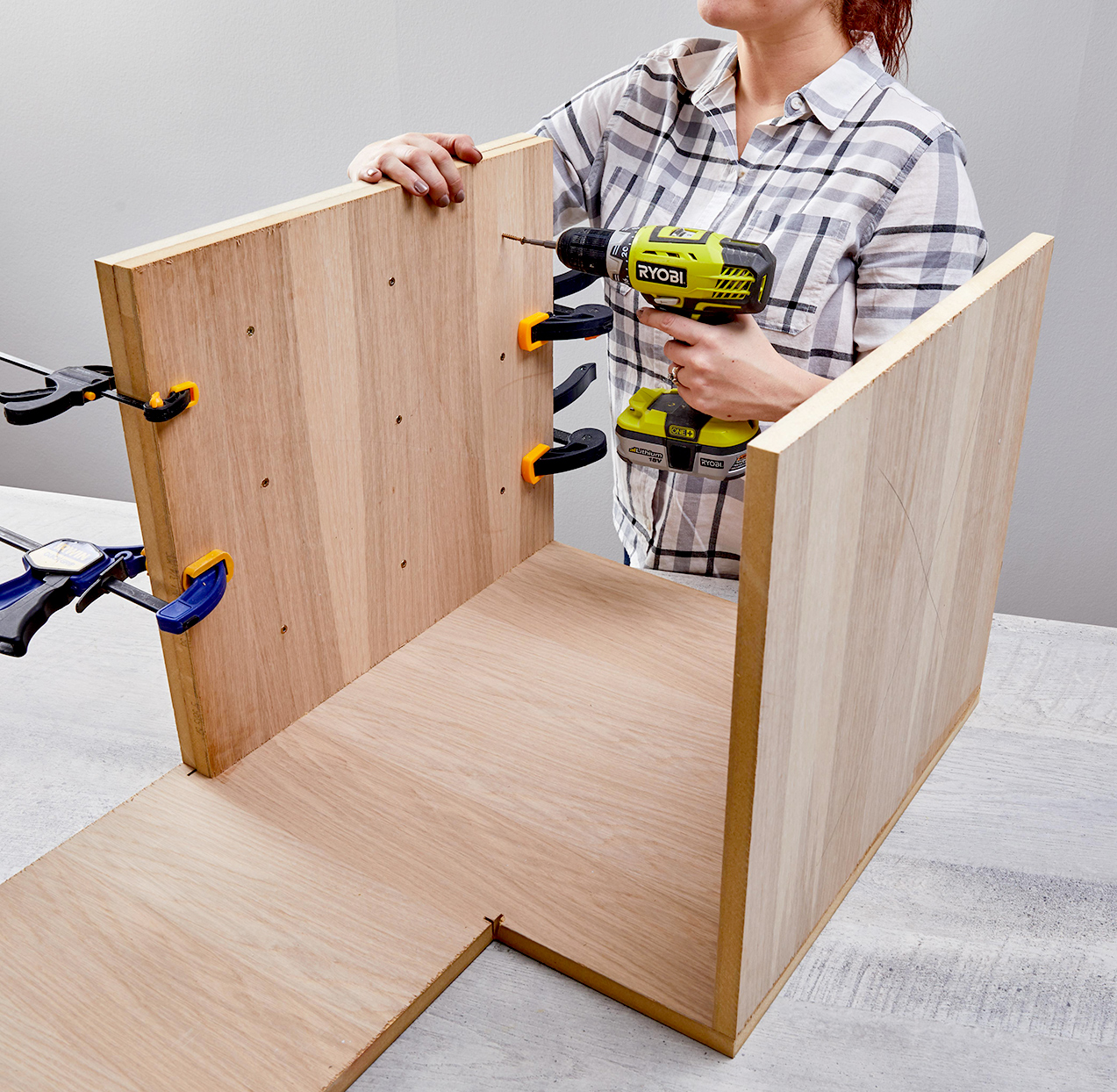 person using drill wood