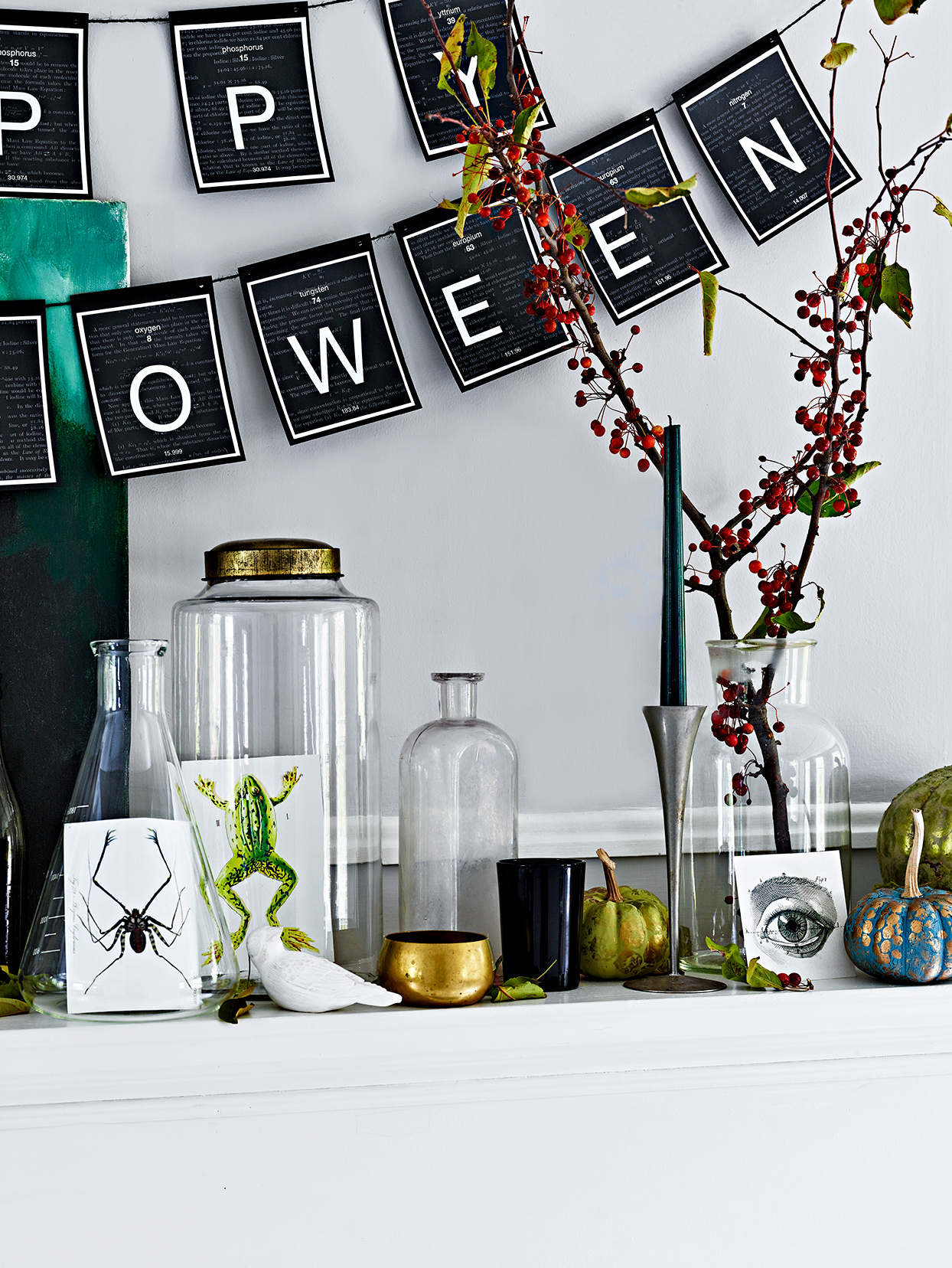 Halloween decorated mantle bottles banner
