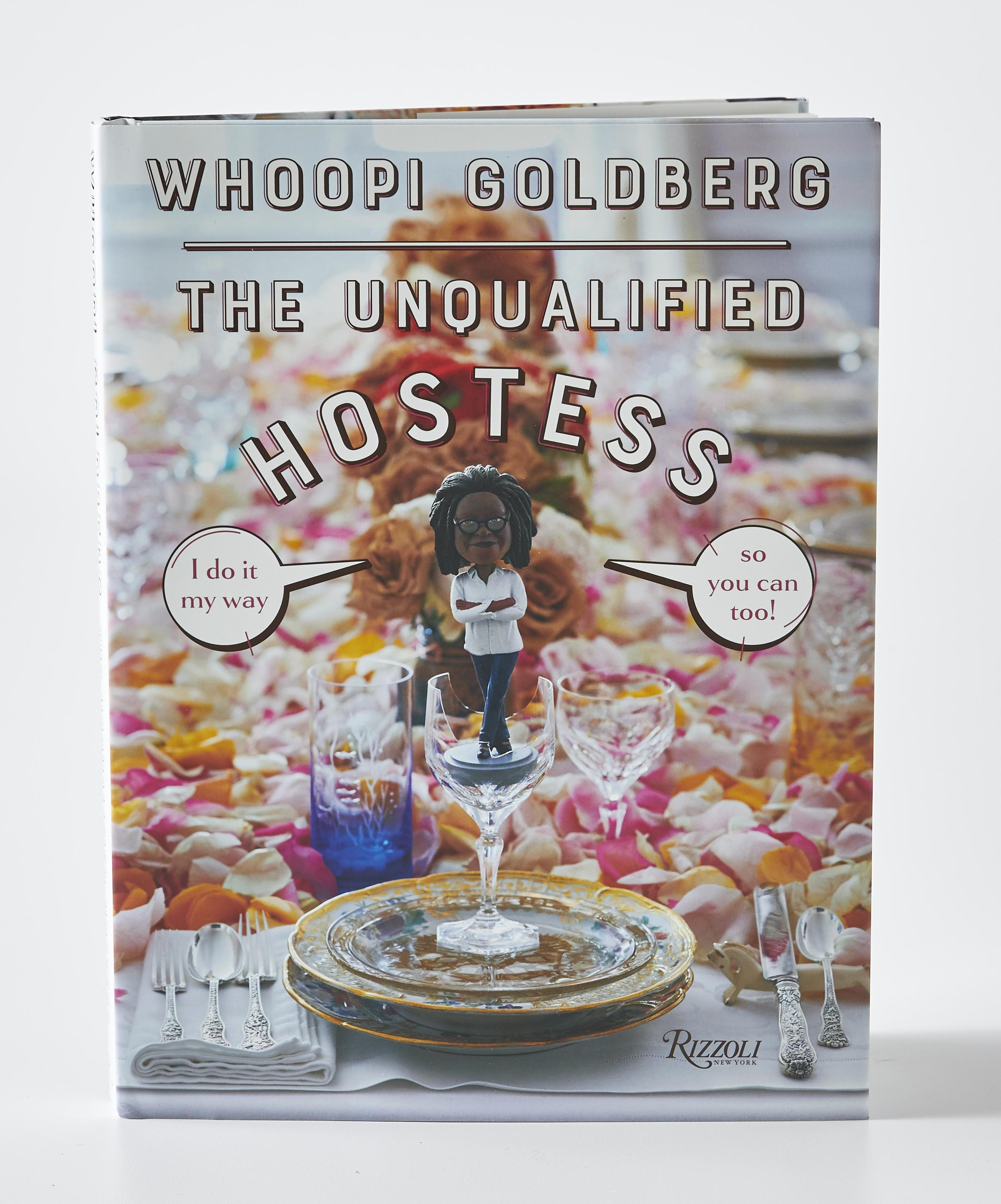 book cover of the unqualified hostess by whoopi goldberg. front cover features a place setting at a tea party with text over the image