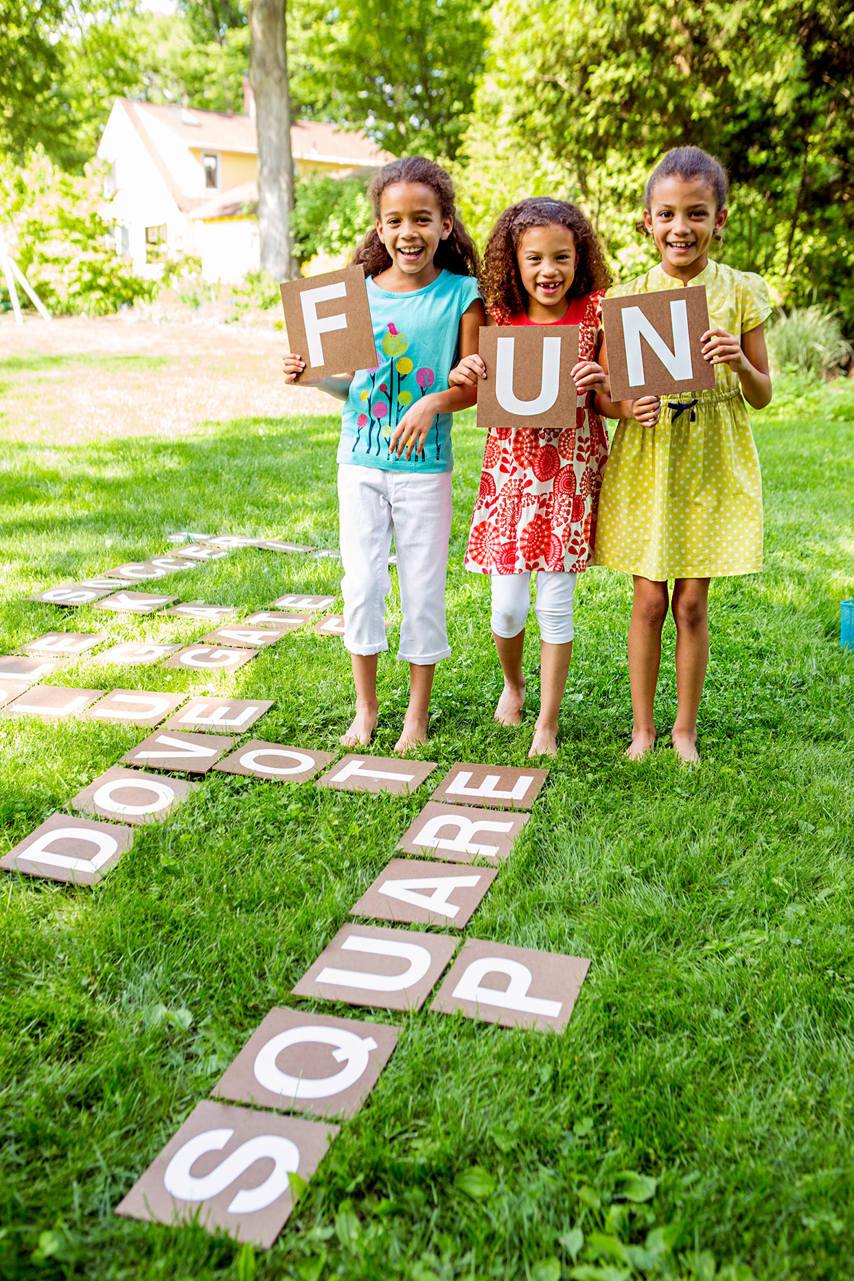 "Children holding letters that spell ""Fun"""