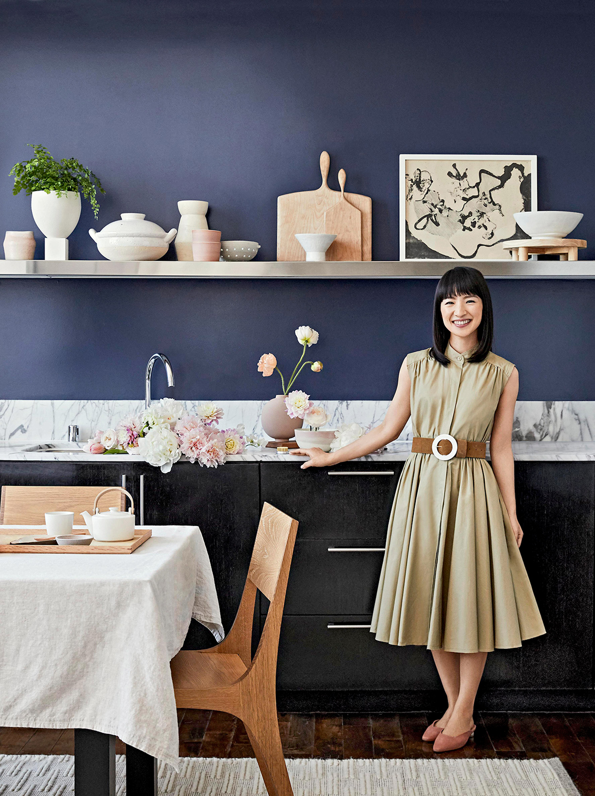 marie kondo in blue kitchen with flowers