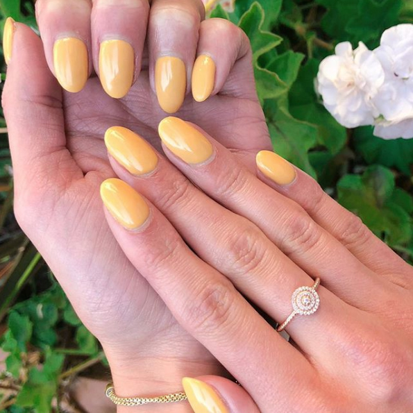 yellow manicured nails