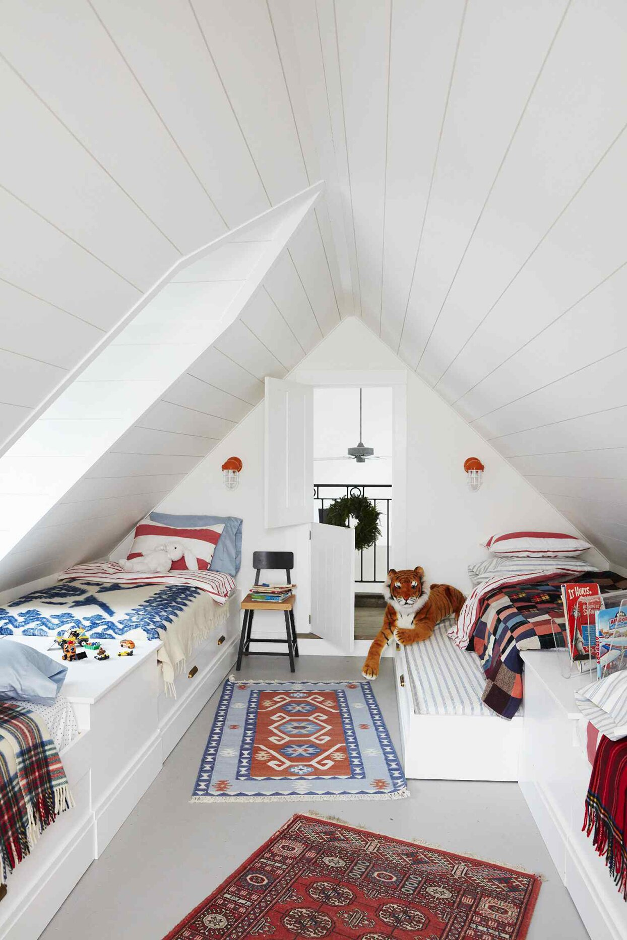 attic loft in a farmhouse with built-in bunks with trundle beds