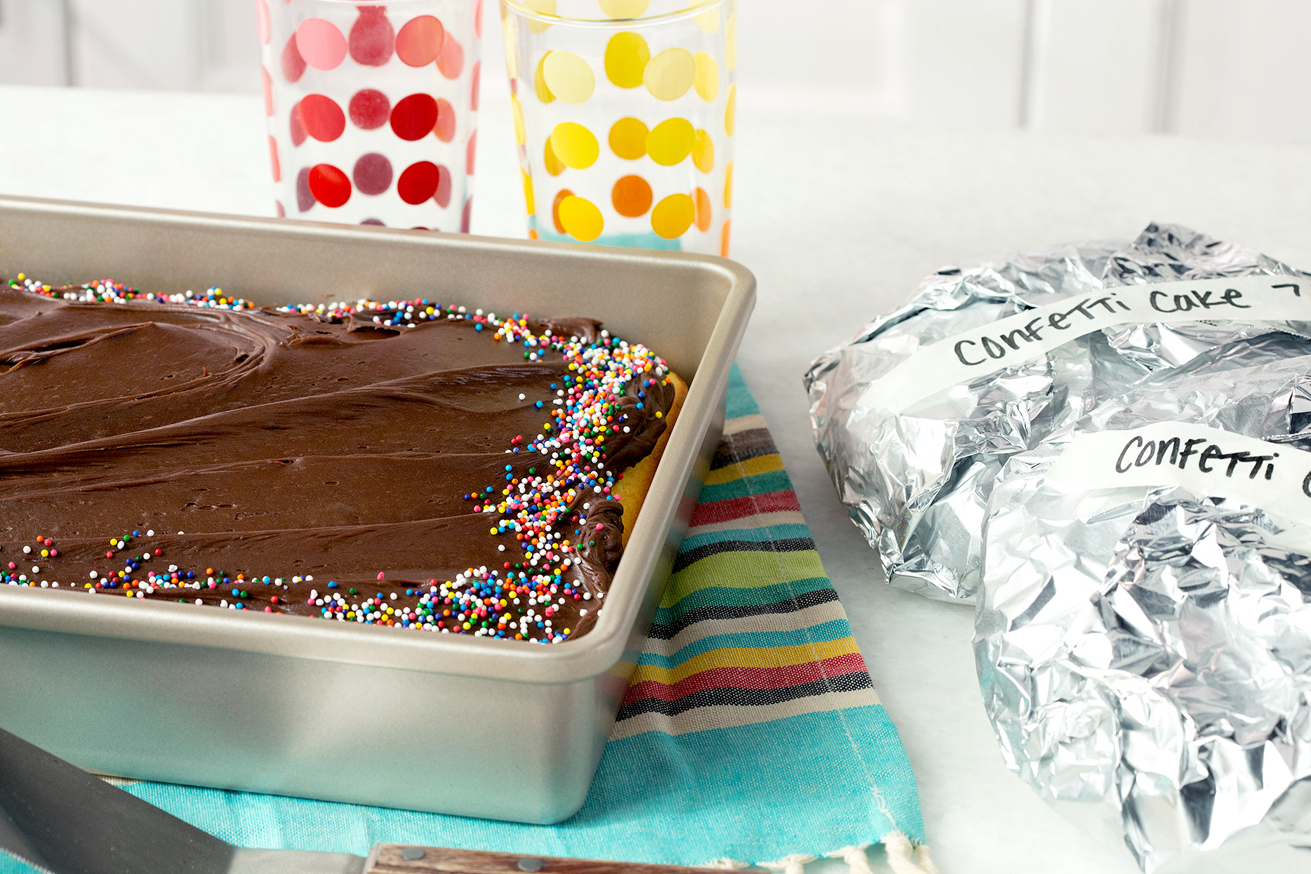 frosted and frozen cake wrapped in foil