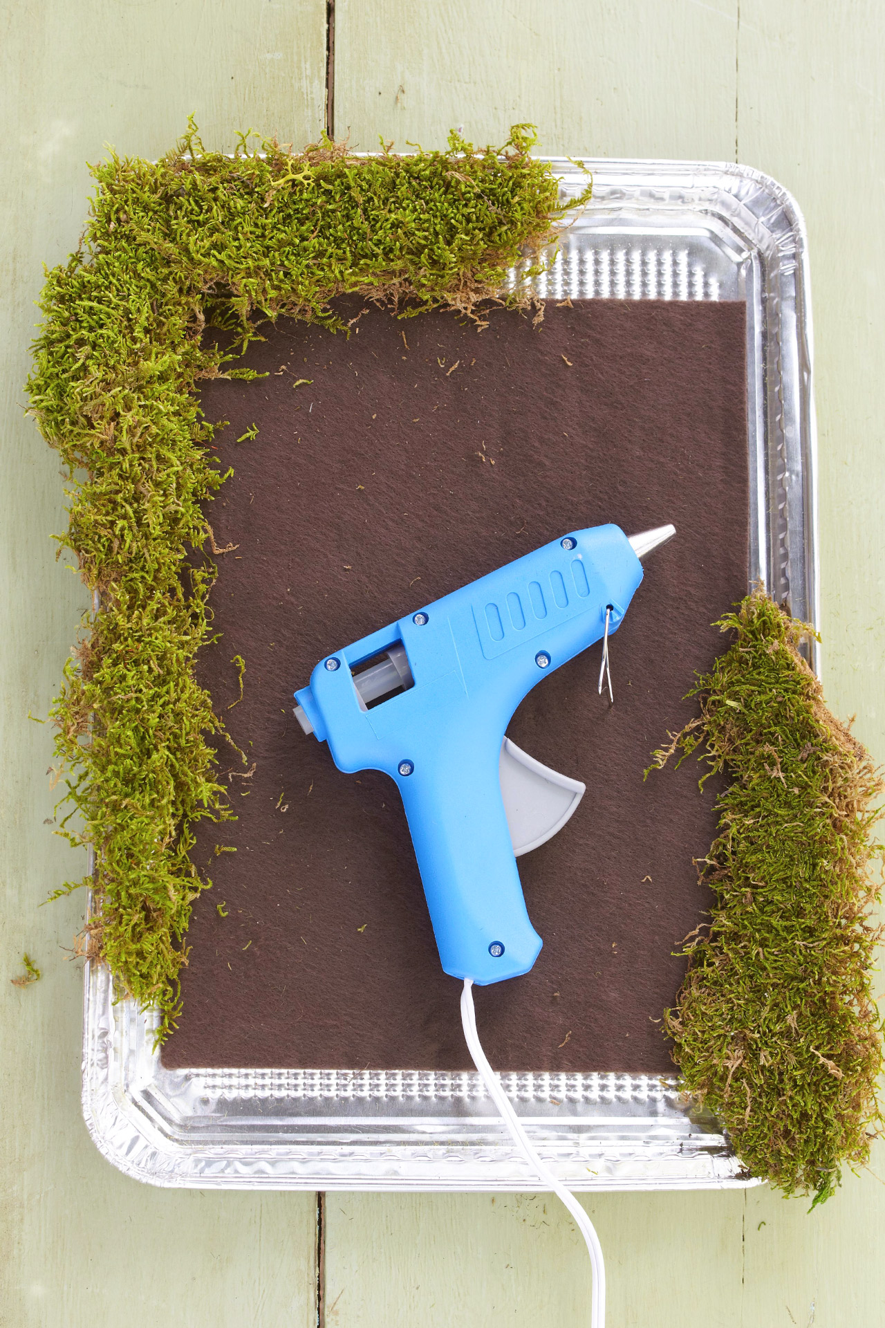 preserved moss covered tray with glue gun