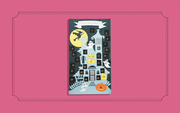 Haunted house advent calendar from Oriental Trading on a pink background