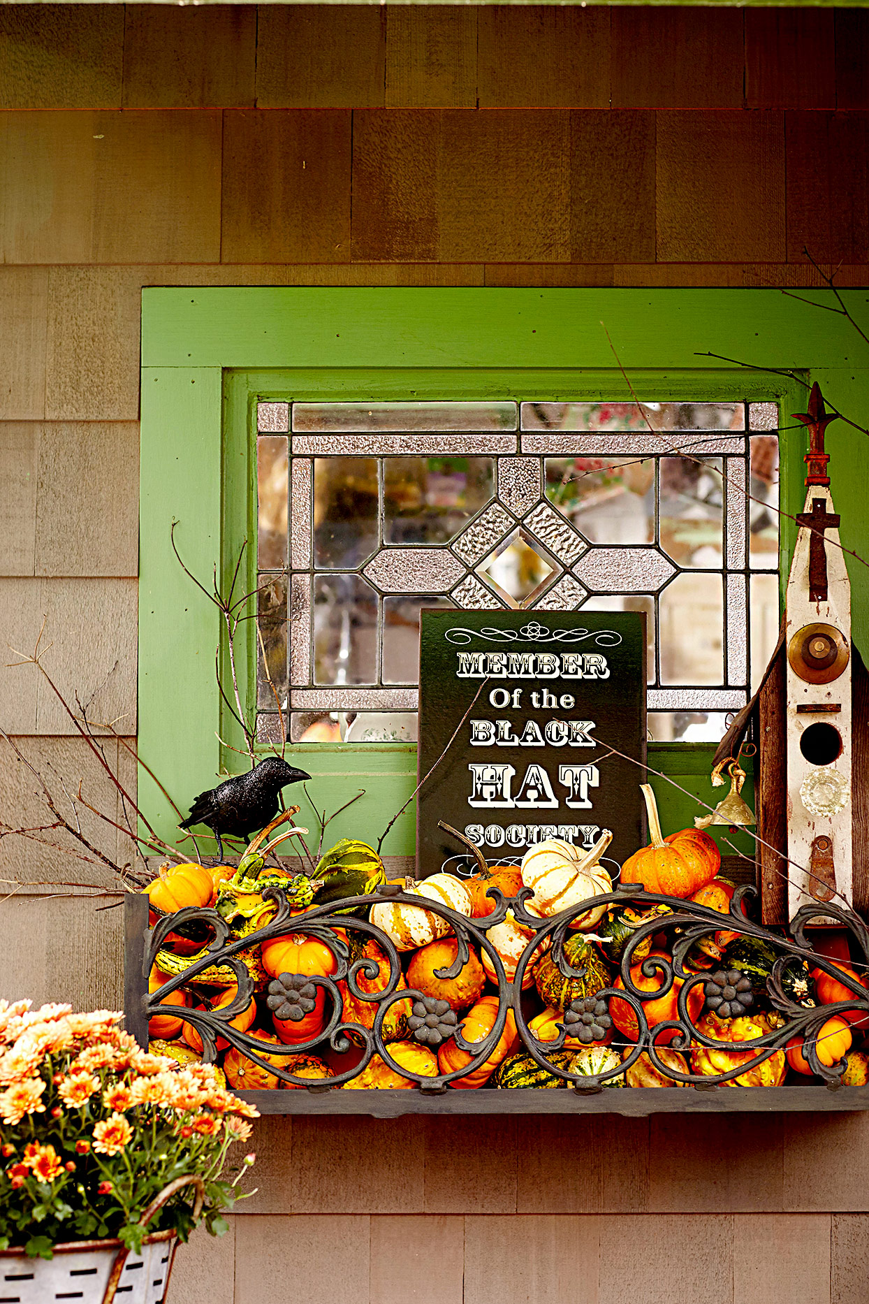 Window with pumpkins and sign