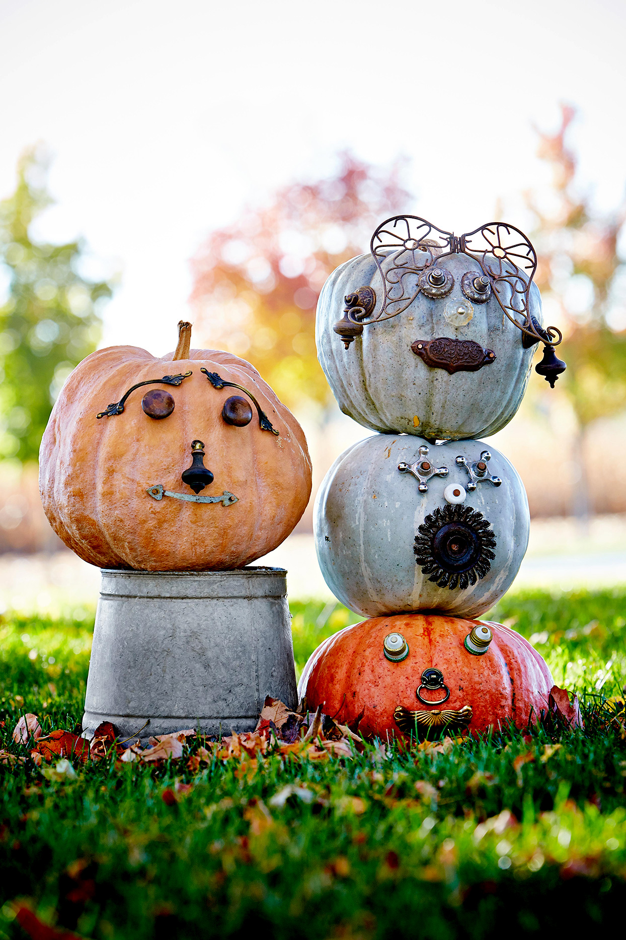 Four pumpkins with face on lawn