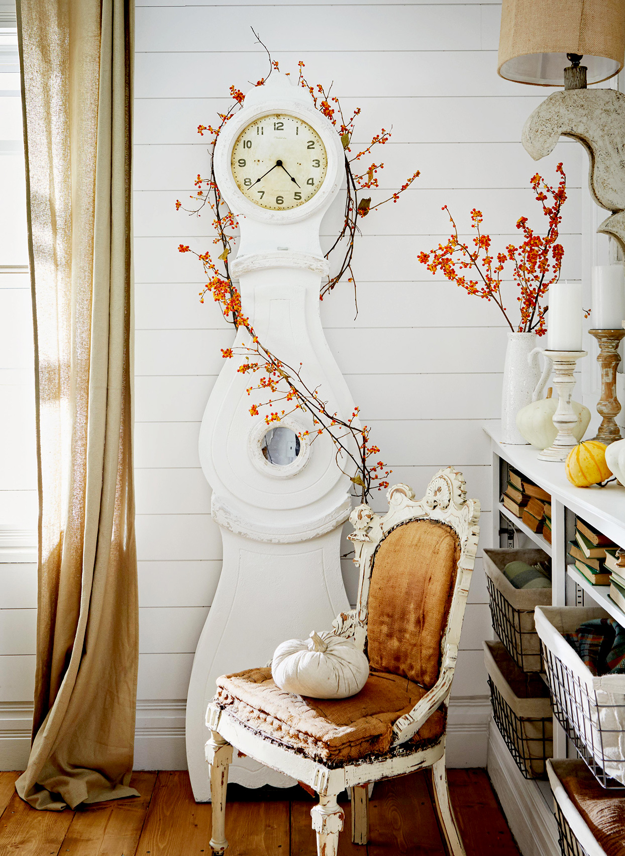 White clock and chair with fall décor