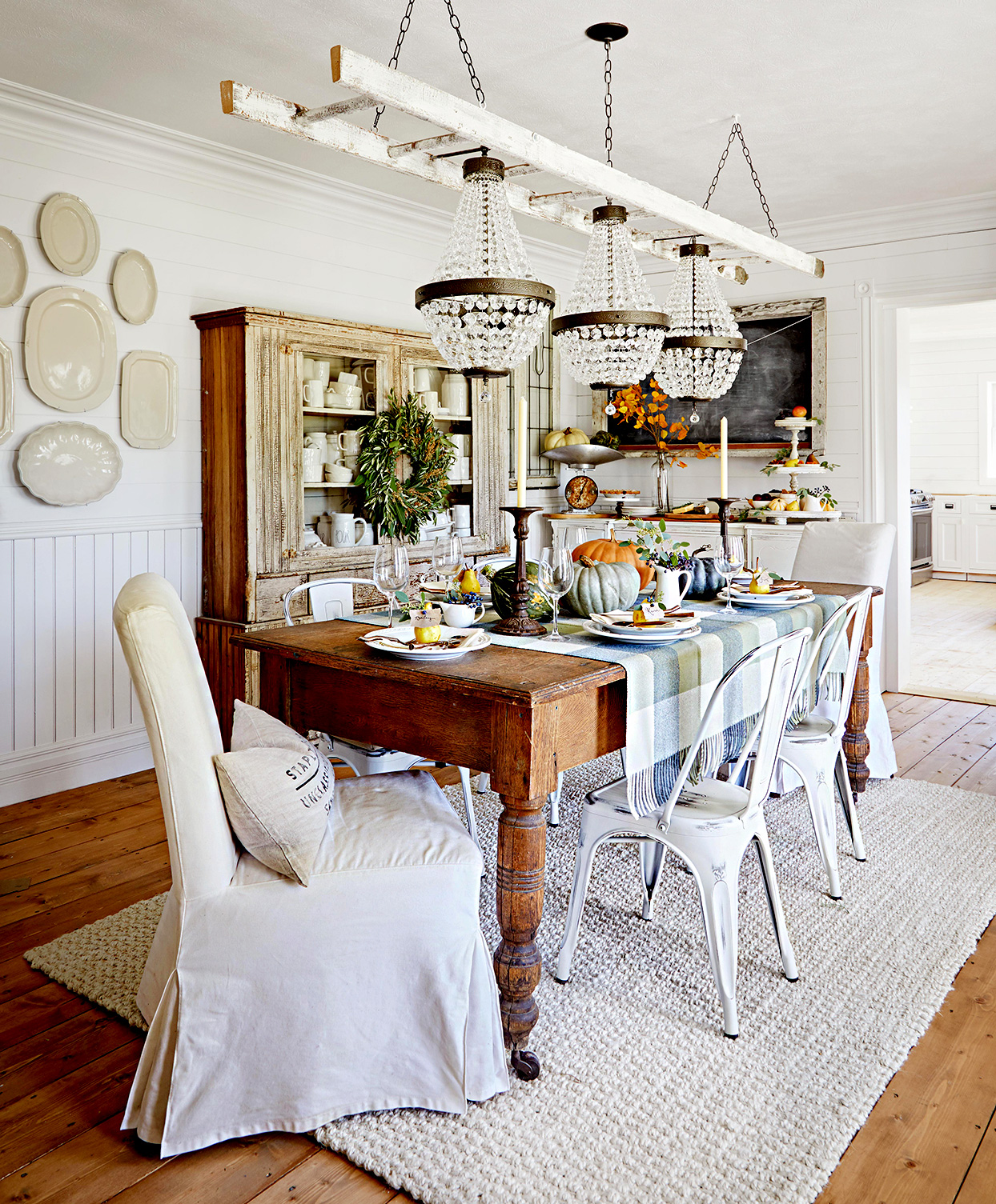 Dining area with wooden table, white metal chairs