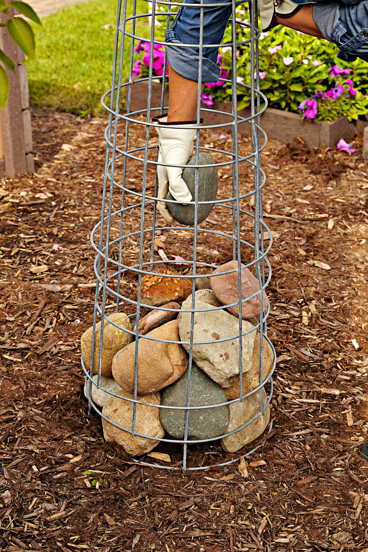 gabion cage filled with stones on mulch