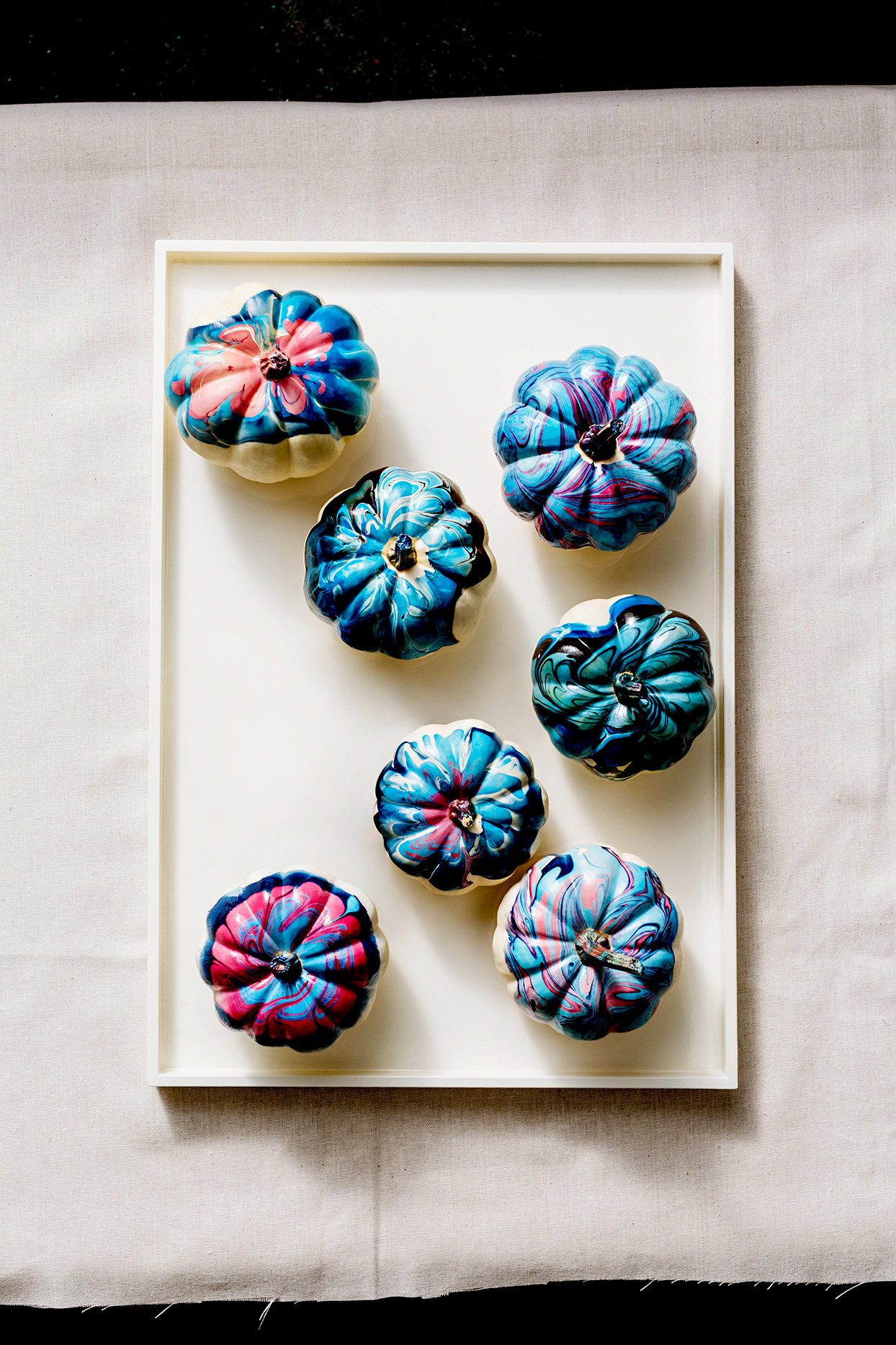 Top view of marble painted pumpkins