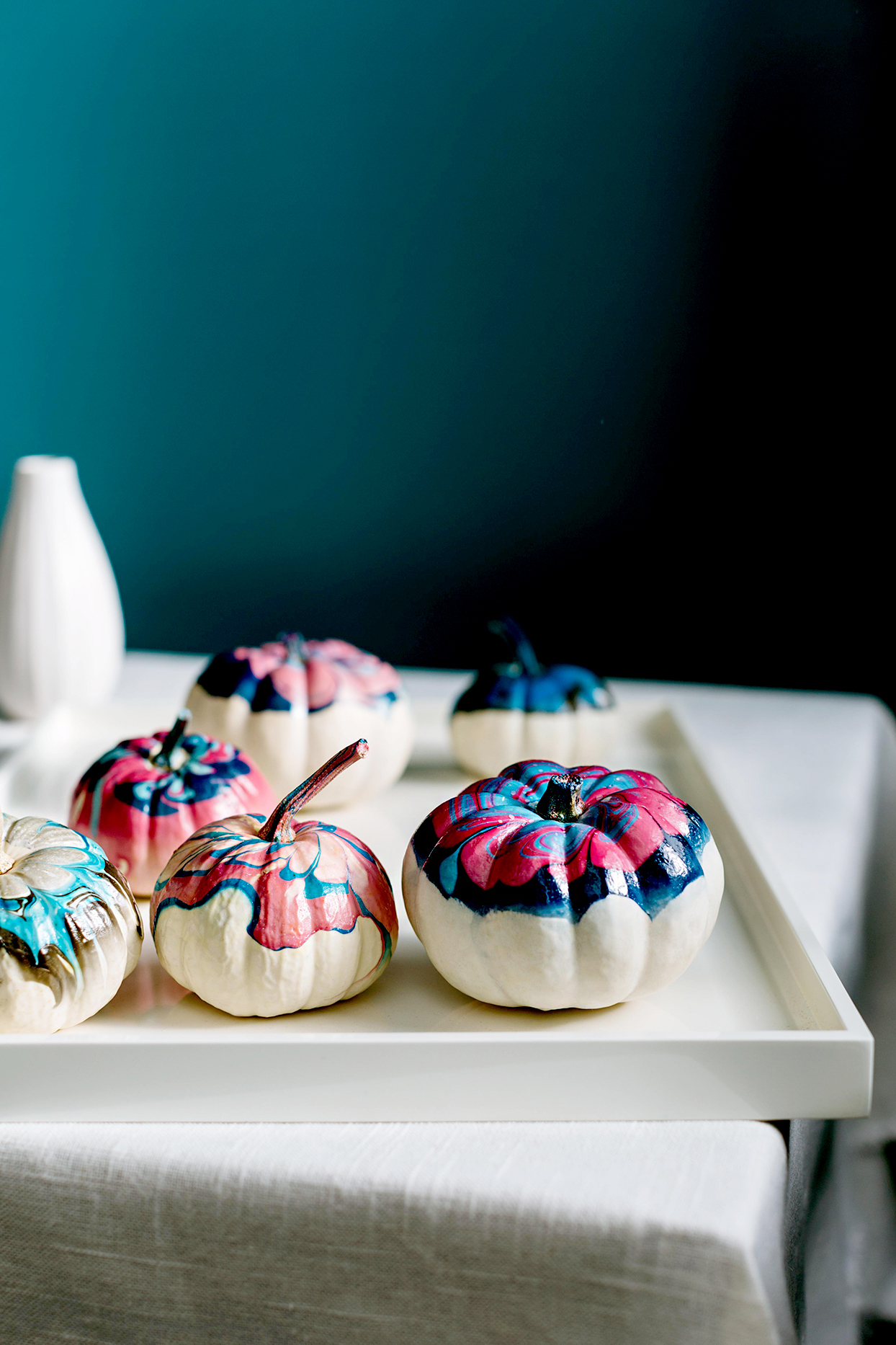 White pumpkins painted marble