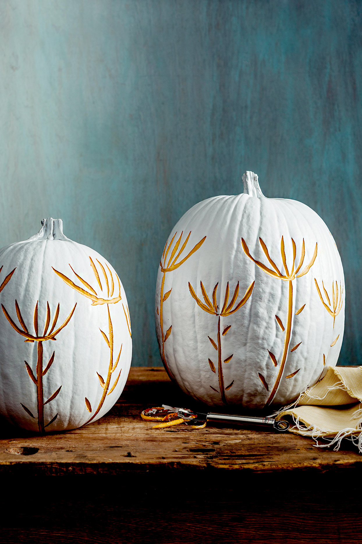 White pumpkins with floral etchings