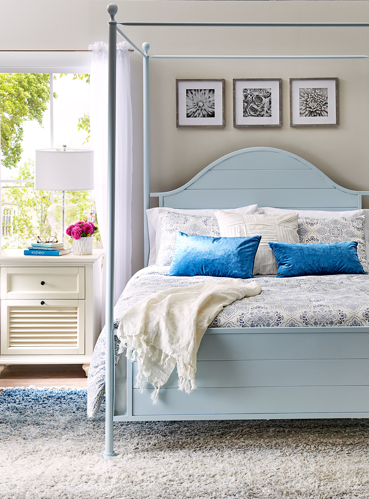 Bedroom with bed, blue pillows