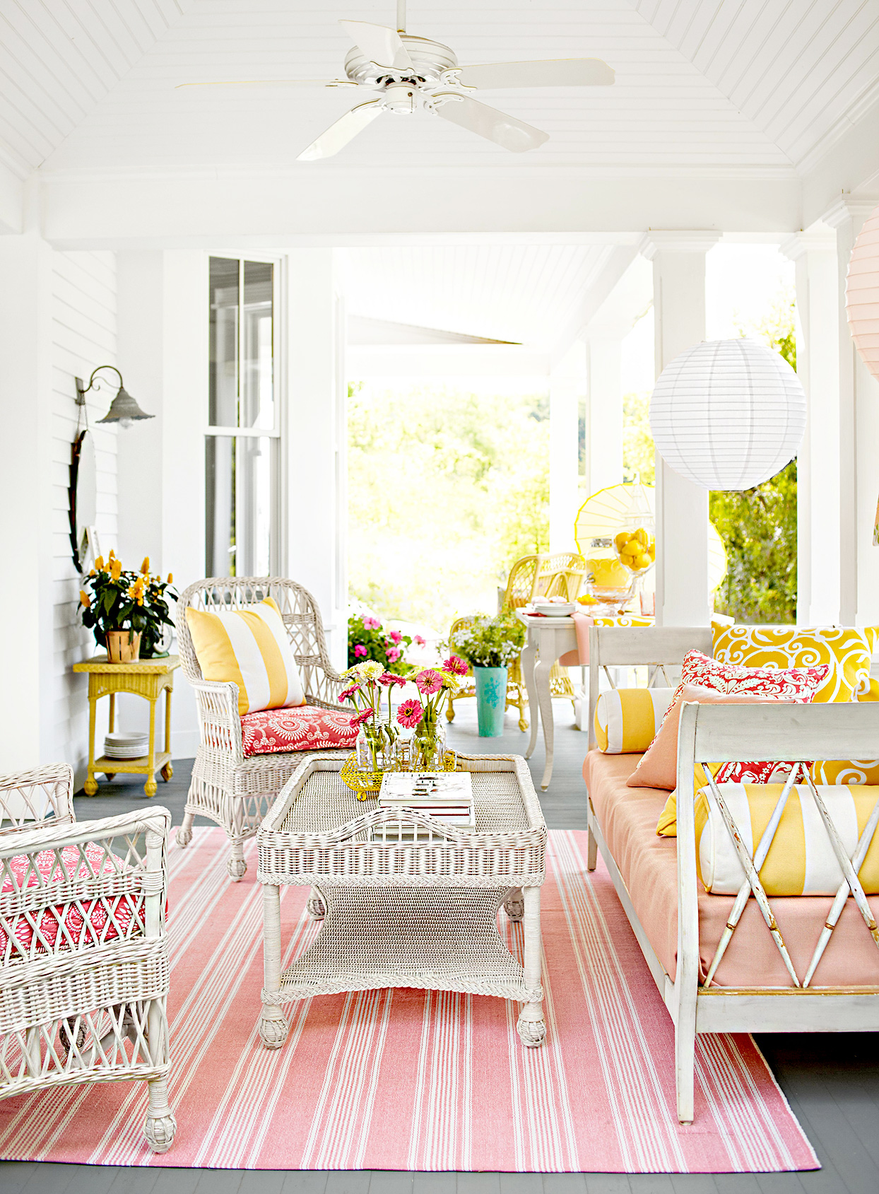 Porch with pink and white theme, wicker furniture