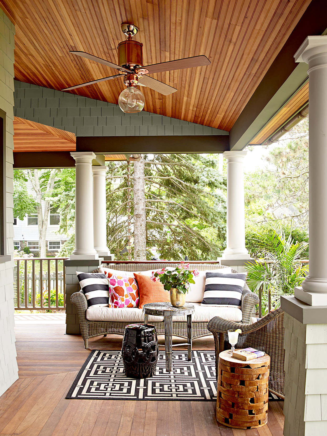 Porch with wicker furniture, pillows